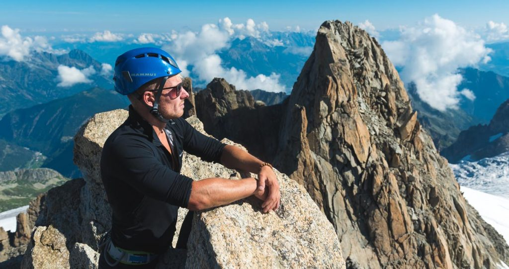 Climber wearing a helmet in the middle of rocks