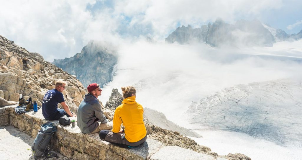 Mountaineers relaxing with a view of a Swiss glacier