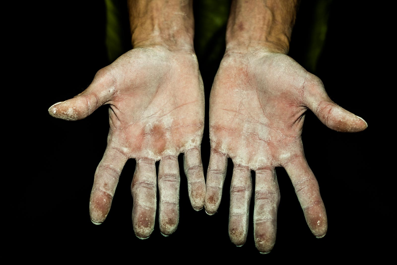 Hands of Russian climber Dmitri Sharafutdinov
