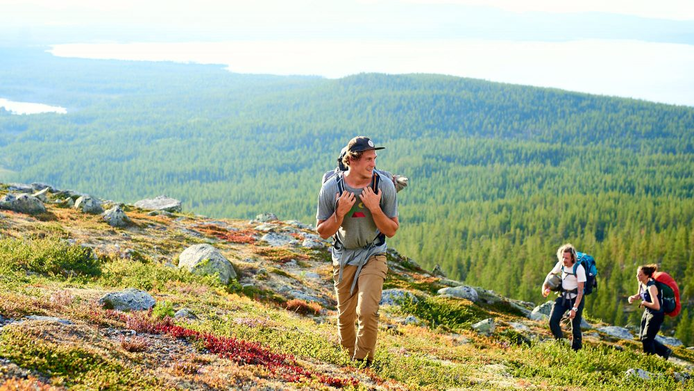 Young male hiking on a hill in Norway
