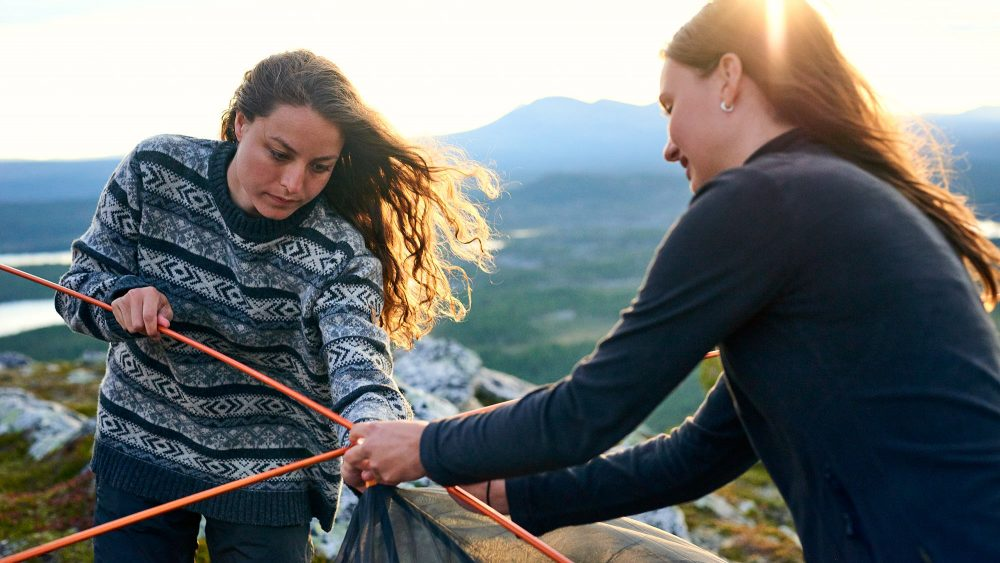 Two women pitching a tent in Norway