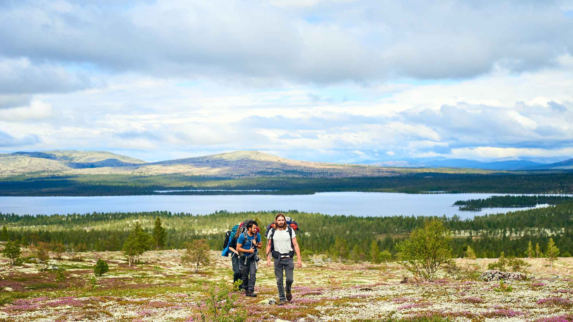 Hikers in a wide landscape in rural Norway