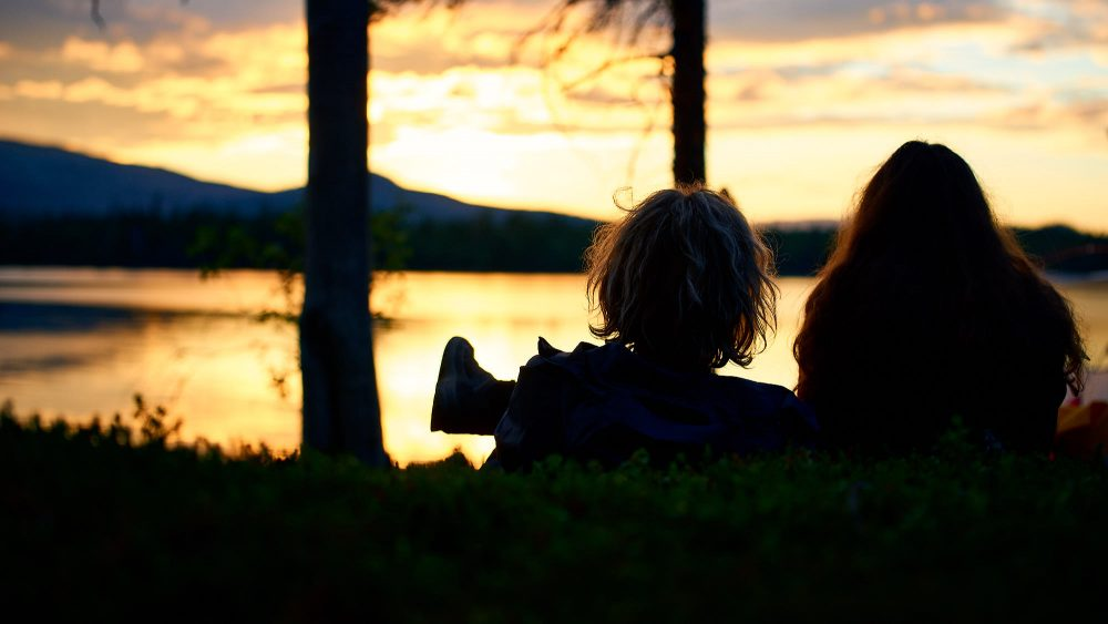 Couple enjoy a romantic sunset in Norway