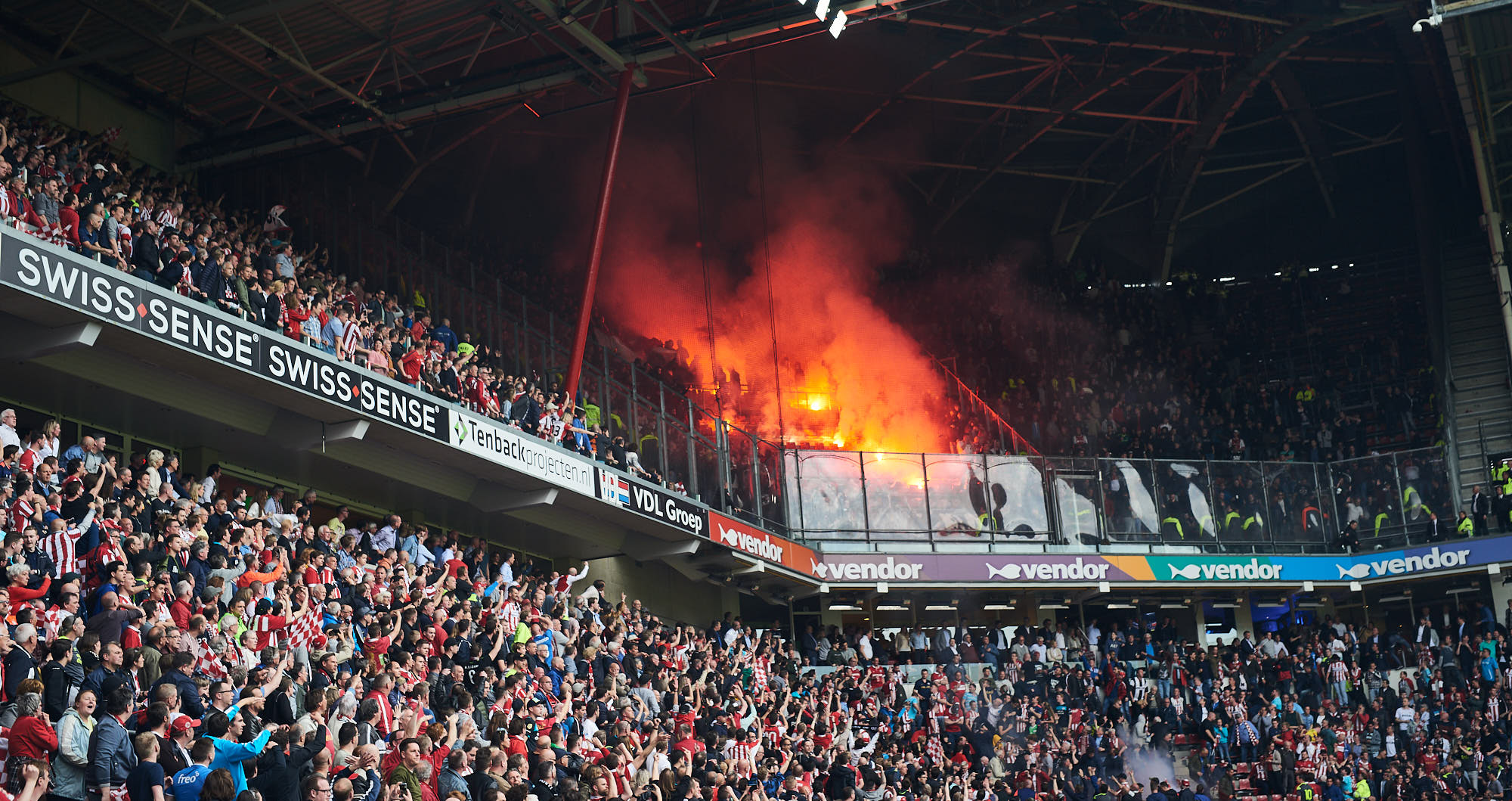 Fire in the away stands housing Ajax supporters in the Philips Stadium