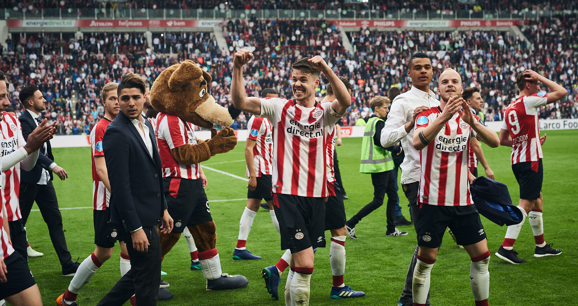 PSV Eindhoven midfielder Marco van Ginkel cheers during title celebrations