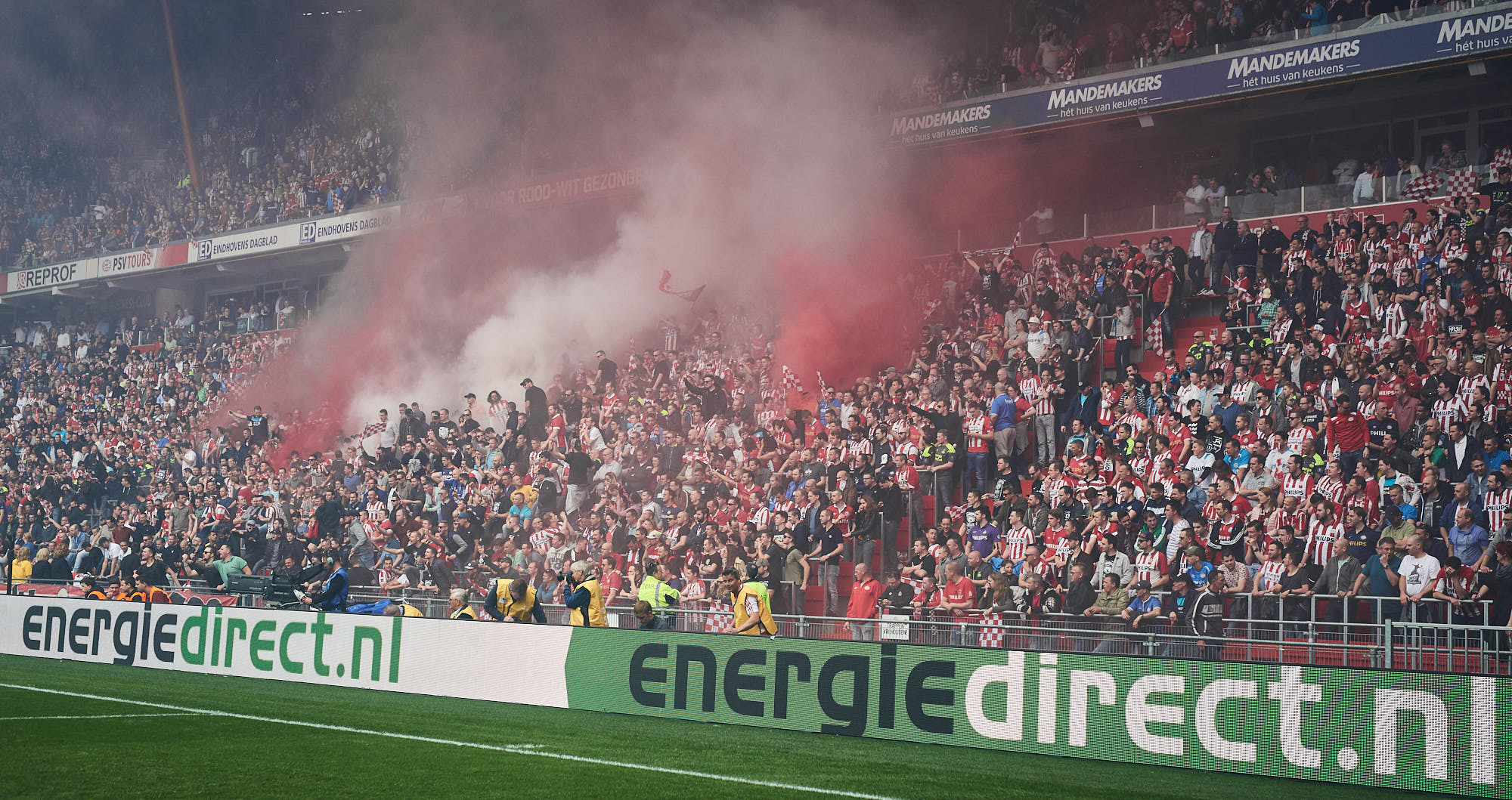 Supporters on the fanatic Oost stands light fireworks