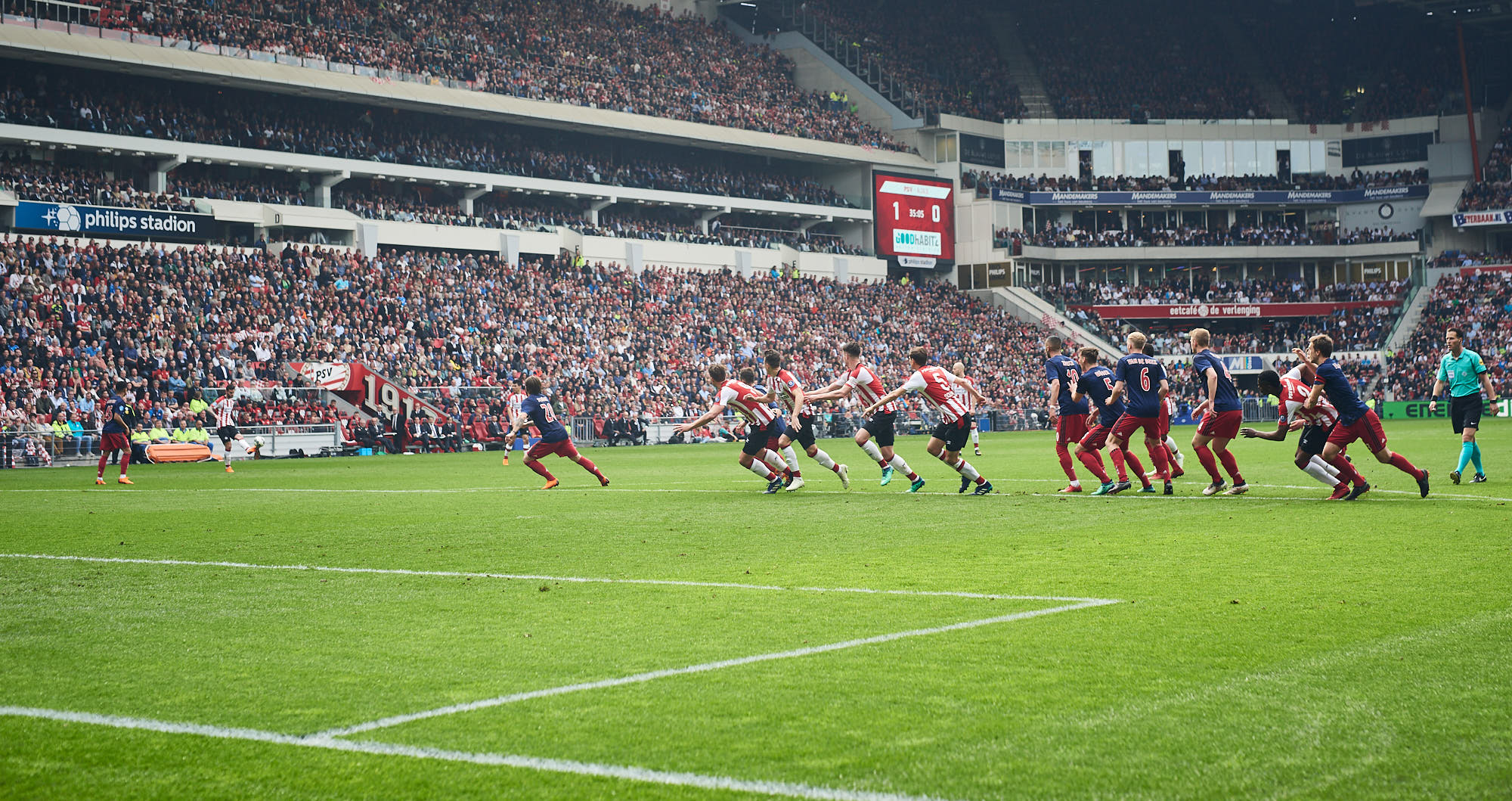 PSV Eindhoven players run towards the Ajax goal during a free kick