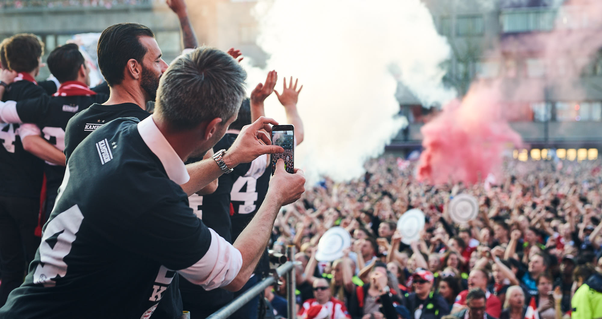 Andre Ooijer makes a snapshot of a square filled with PSV supporters