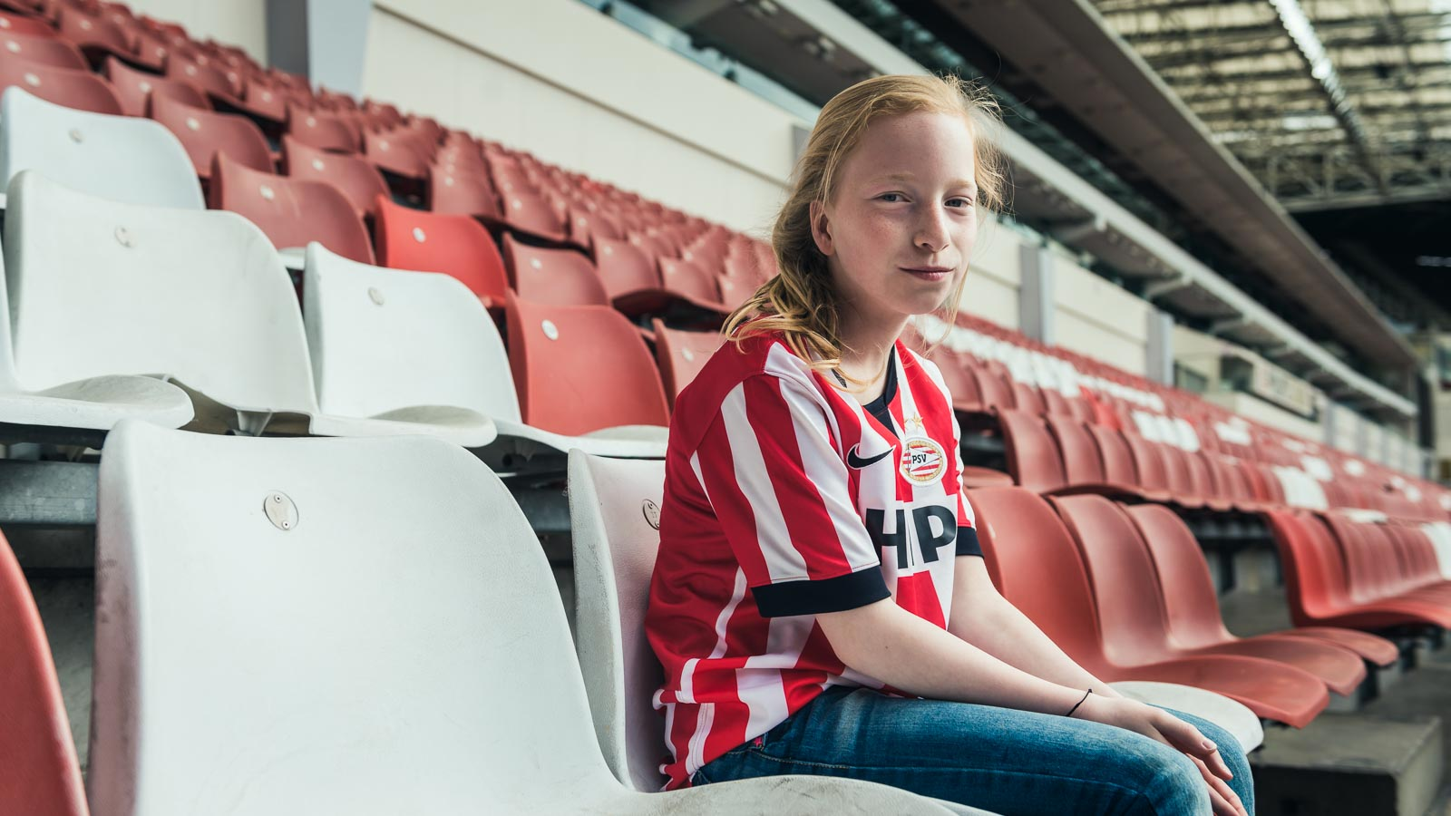 Young fan in the Philips Stadium for a PSV Eindhoven marketing campaign