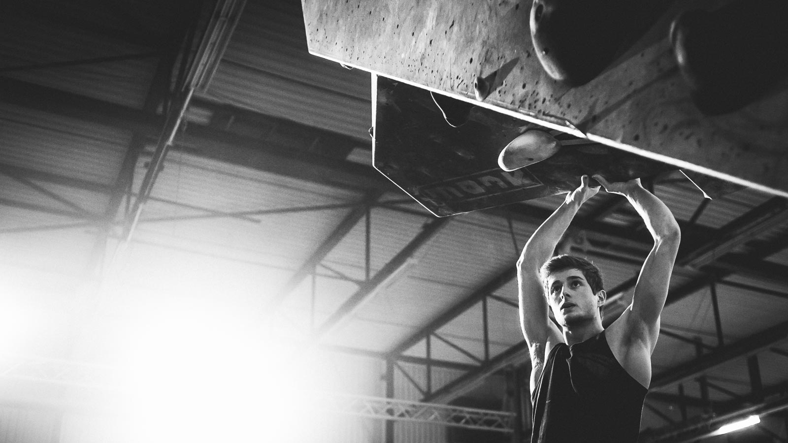 Focus on an the face of an athlete before climbing