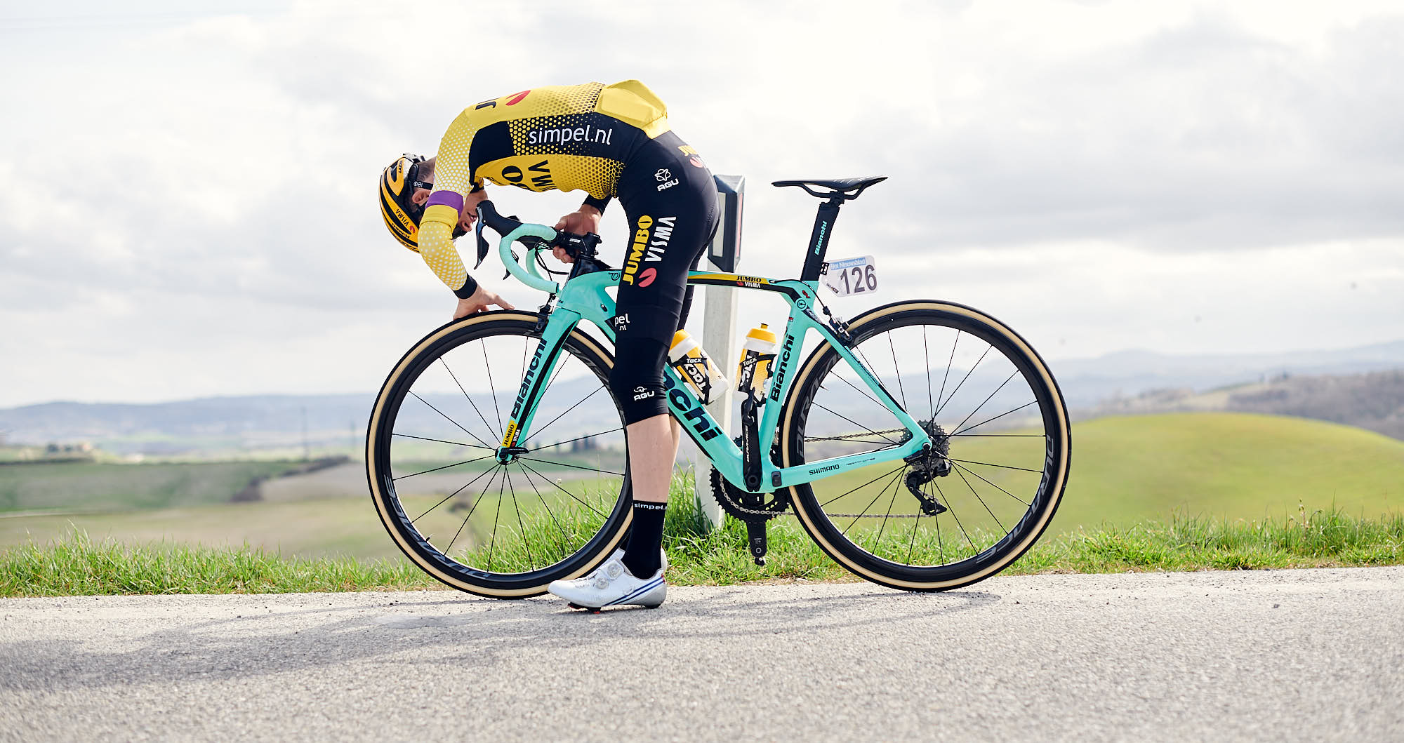 Floris de Tier checking tire pressure on his Bianchi
