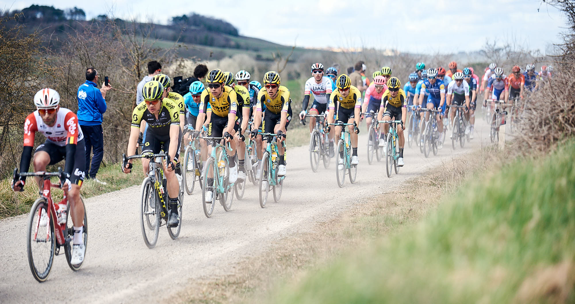 Cyclists on Strade Bianche, or literally white roads