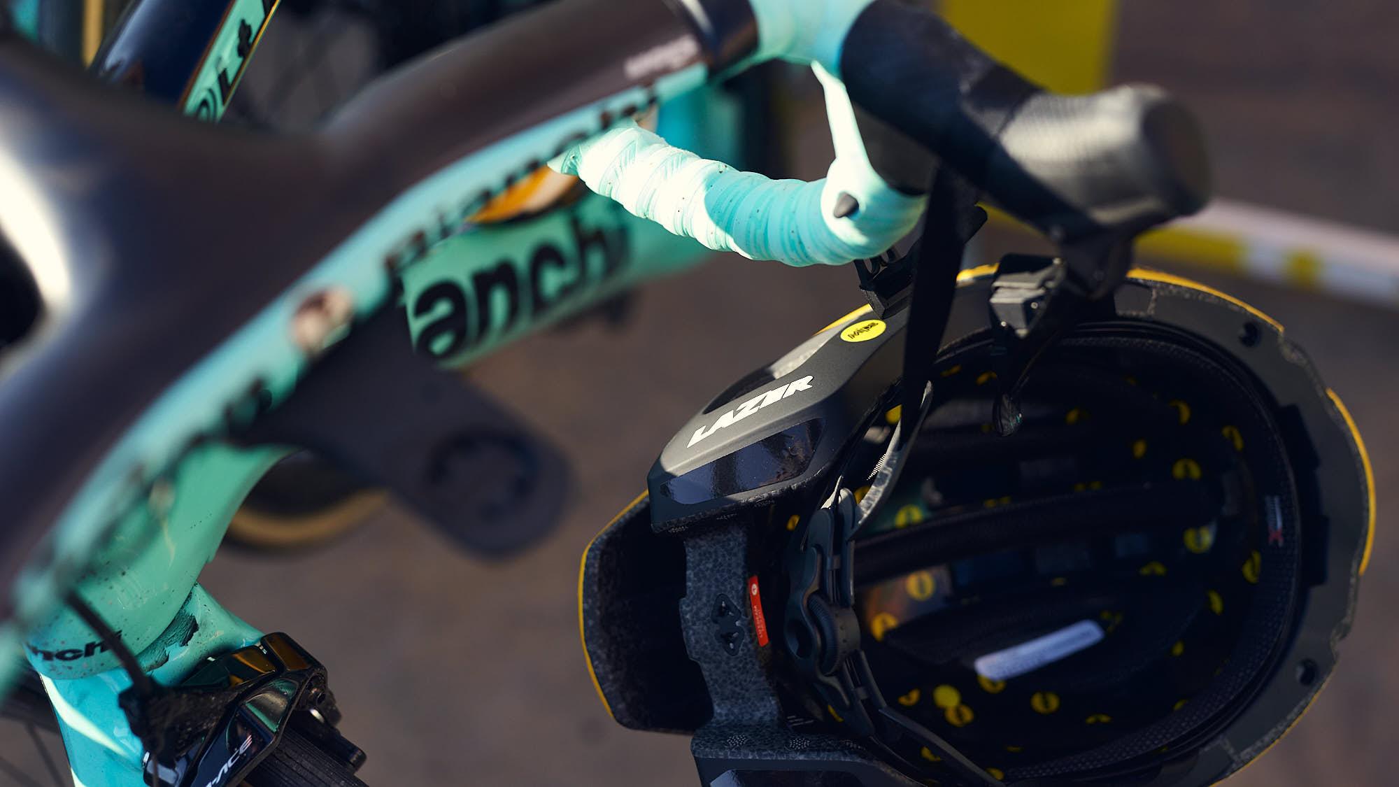 Lazer helmet hanging from a Bianchi bike's handlebars