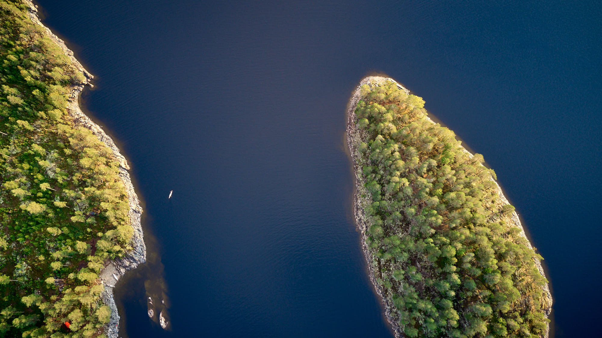 Top down view from a drone of islands on a lake in Sweden