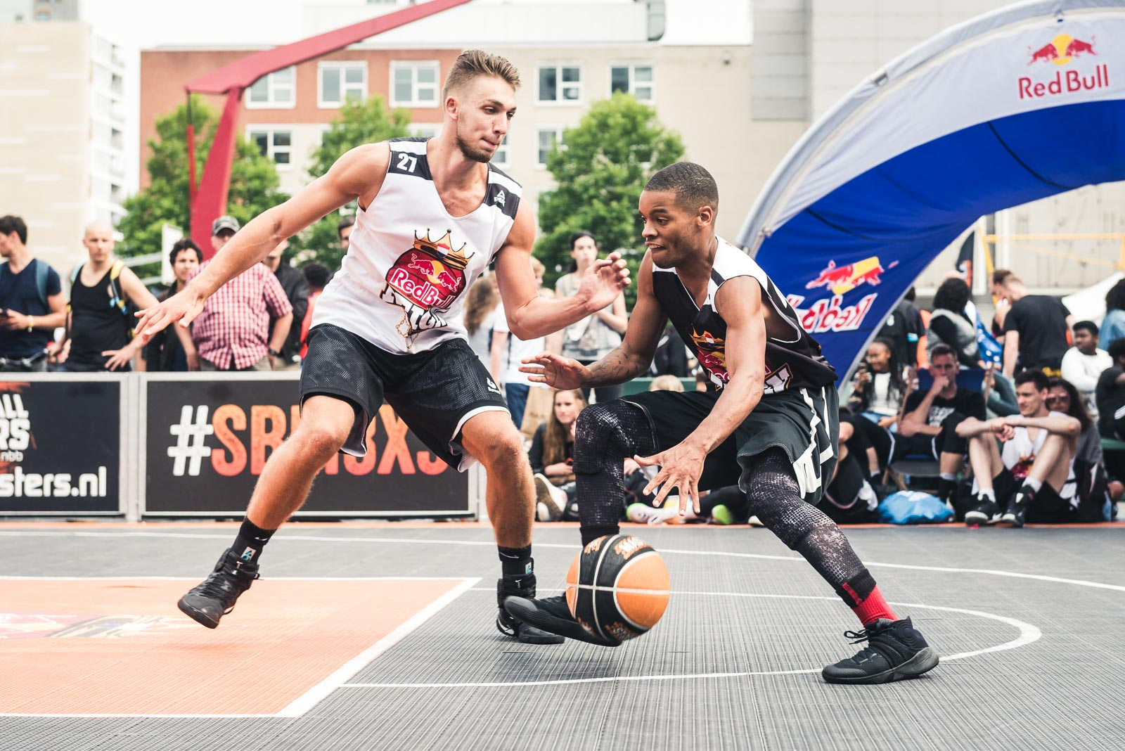Basketball player makes a passing move during Red Bull Reign