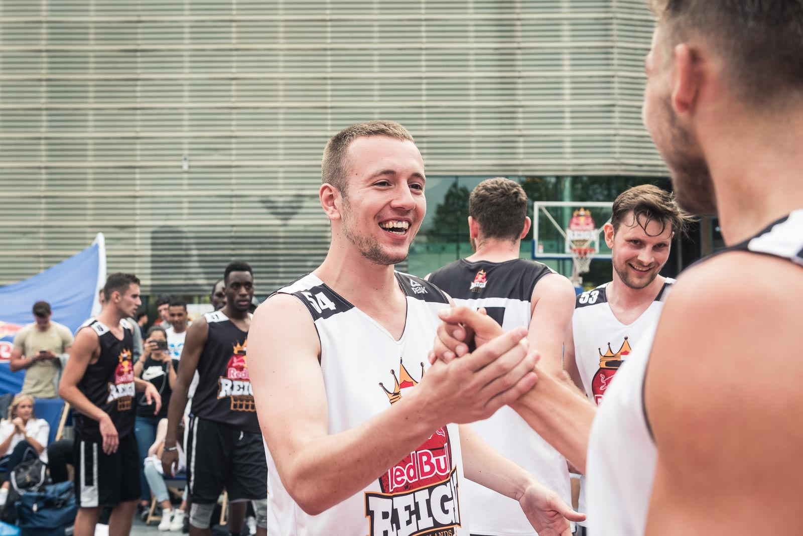 Basketball players in Rotterdam shake hands during Red Bull Reign