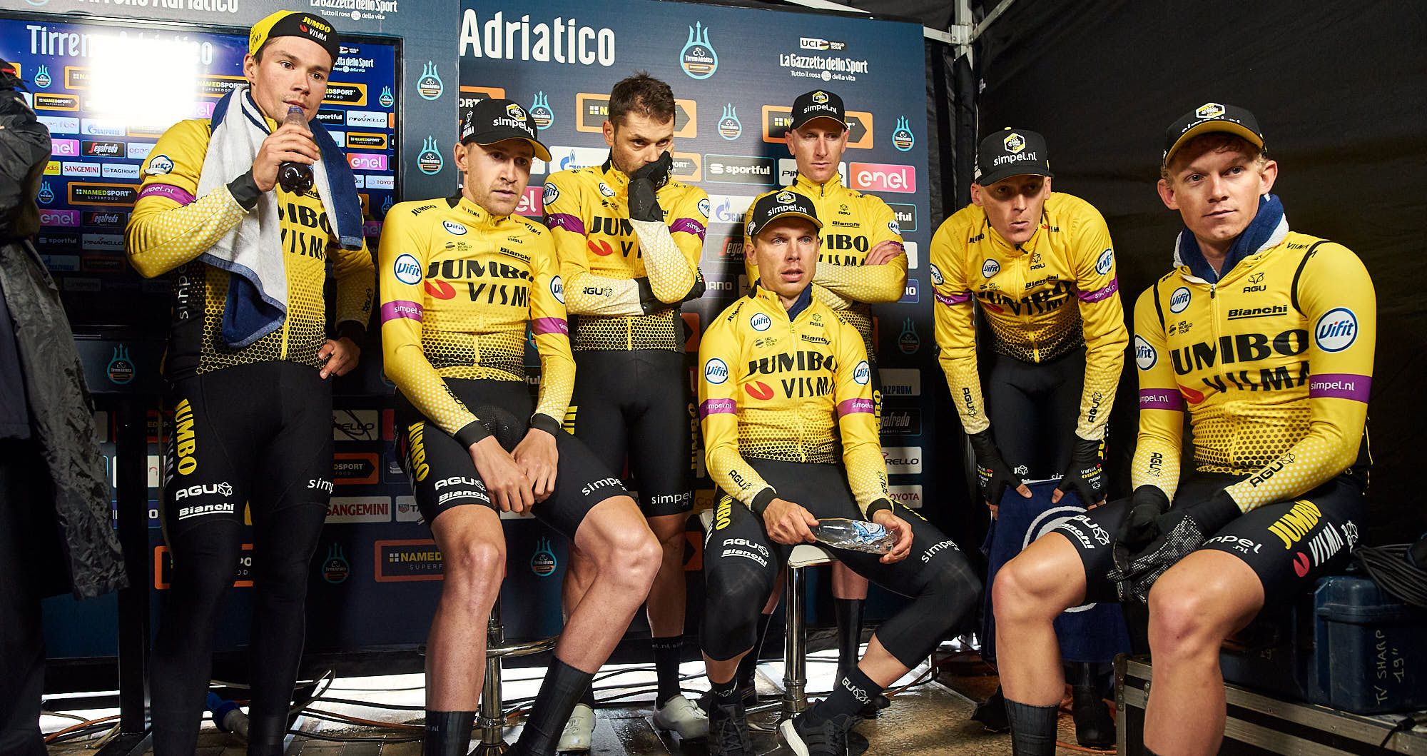 Jumbo-Visma cycling team watching results after finishing