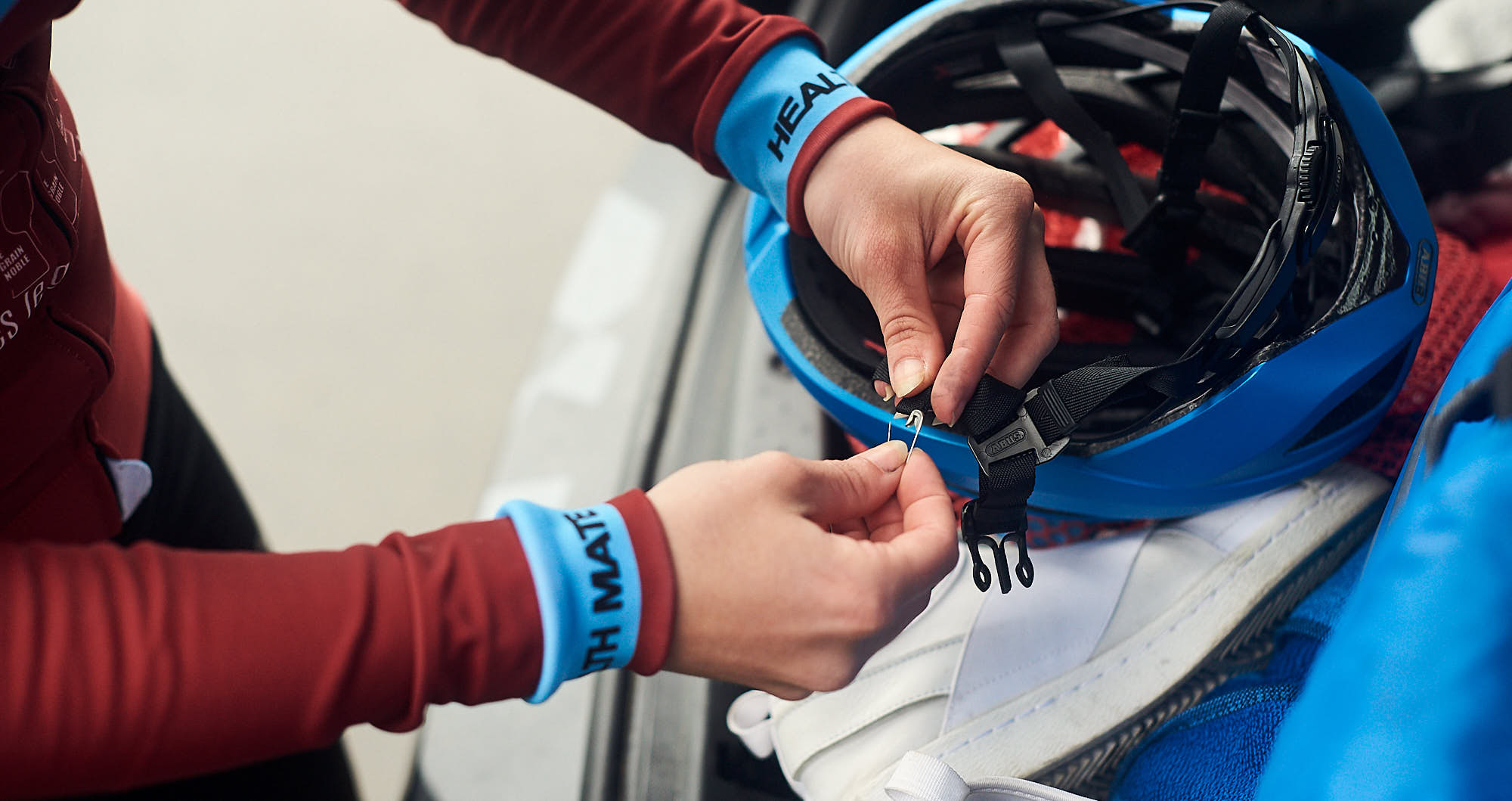 Cyclist fixing her helmet