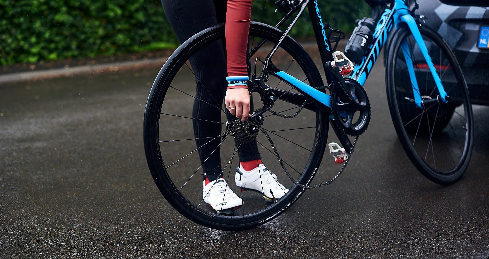 Cyclist installing a rear wheel in their bike