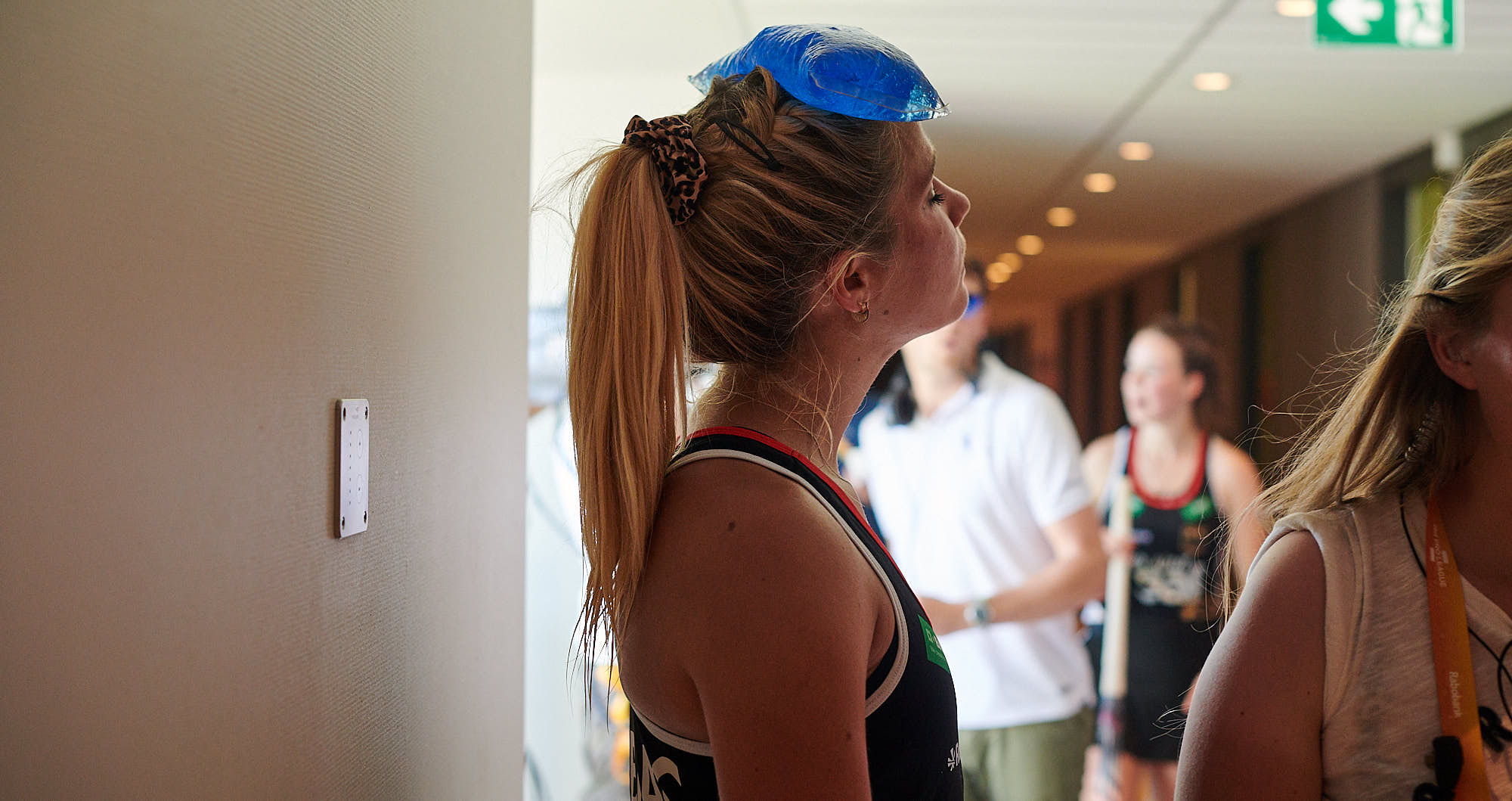 German national hockey team player puts ice on her forehead before FIH Pro league finals in Amsterdam