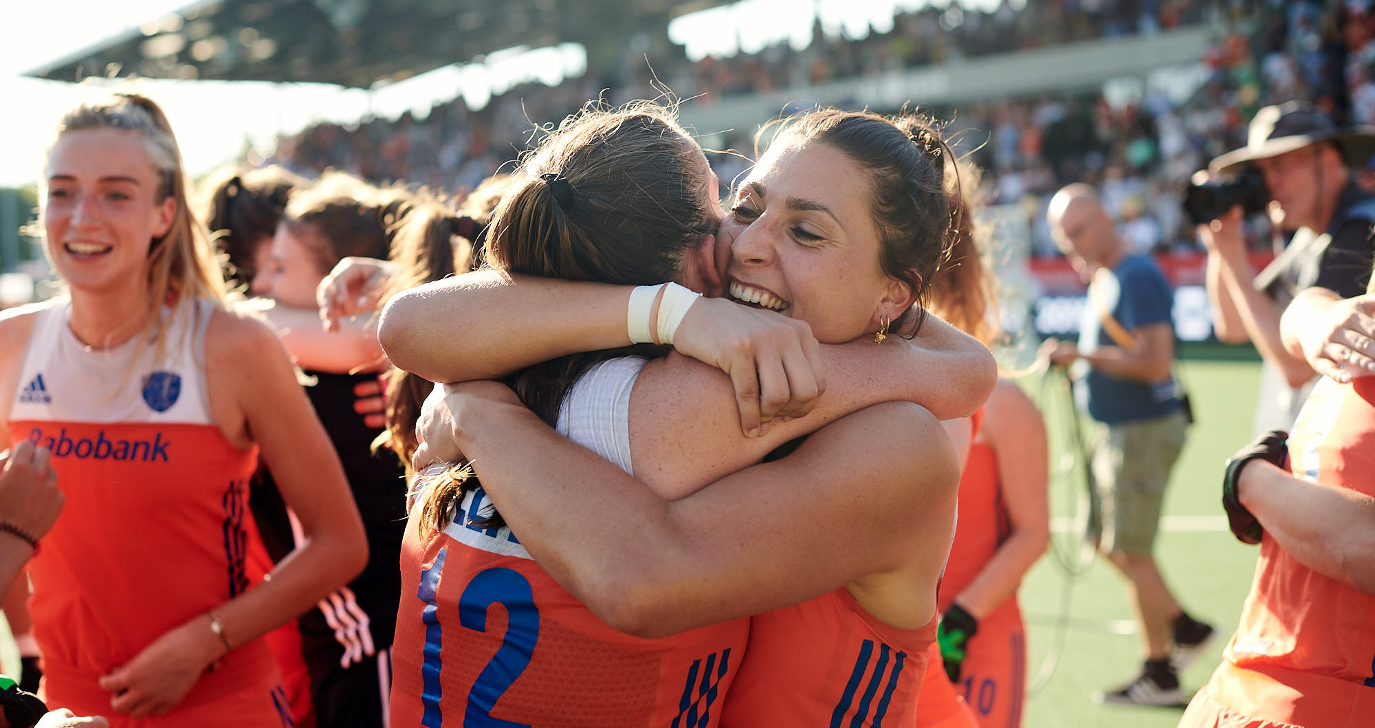 Two Dutch national female hockey team players embrace