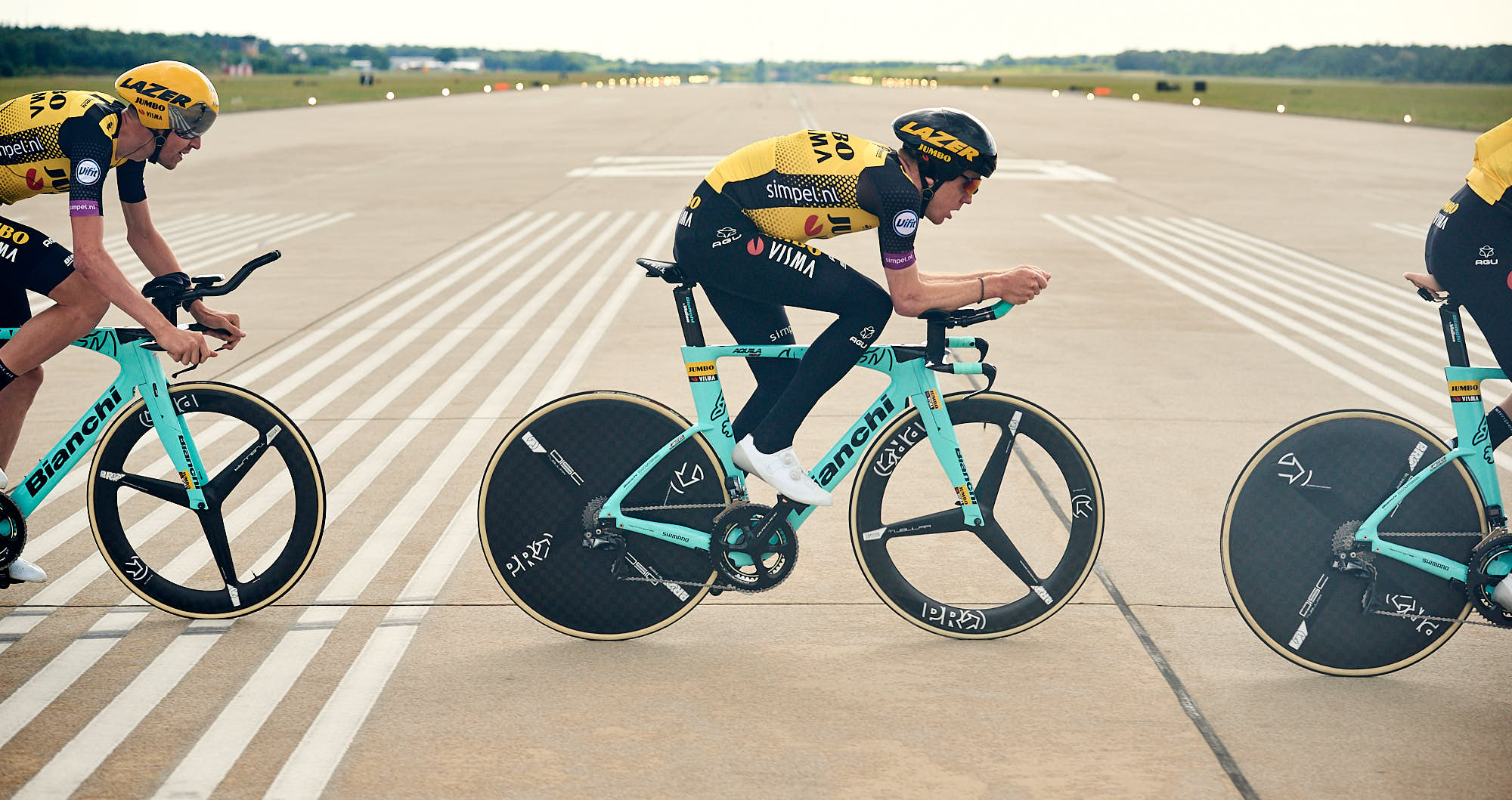 Jumbo-Visma's Steven Kruiswijk perfecting his time trial skills at an airport