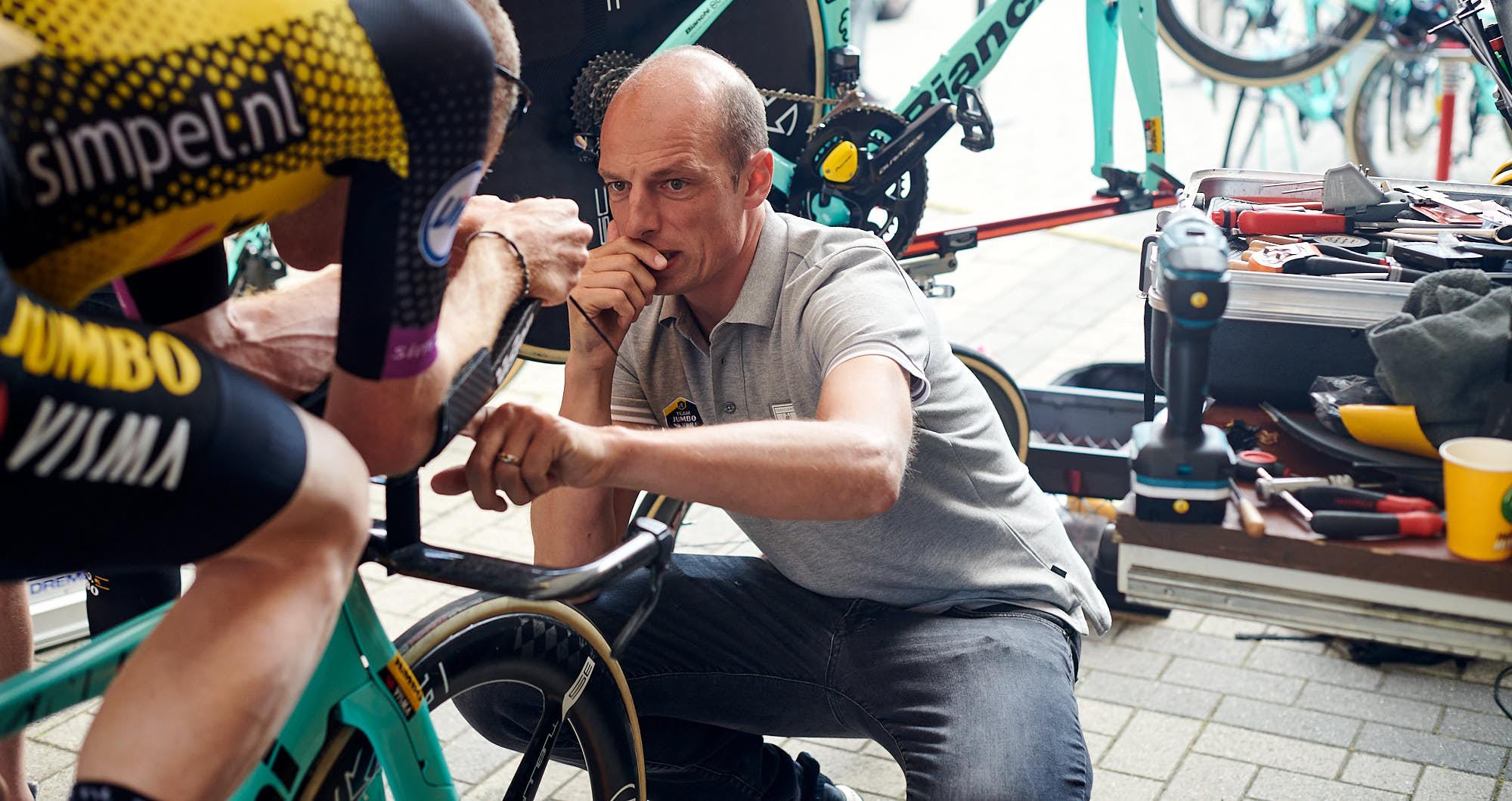 Jumbo-Visma's Mathieu Heijboer fine-tuning a bike setup