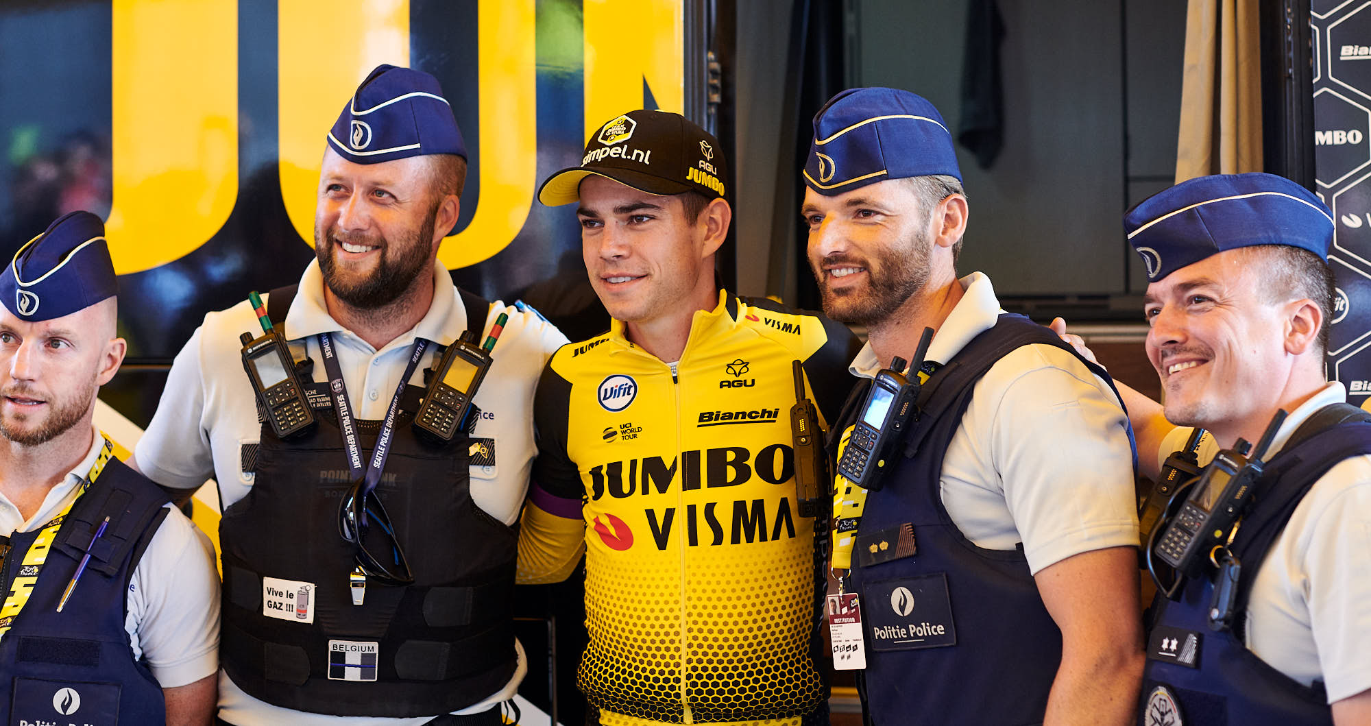 Wout van Aert with two Brussels police officers after the team time trial in the 2019 Tour de France