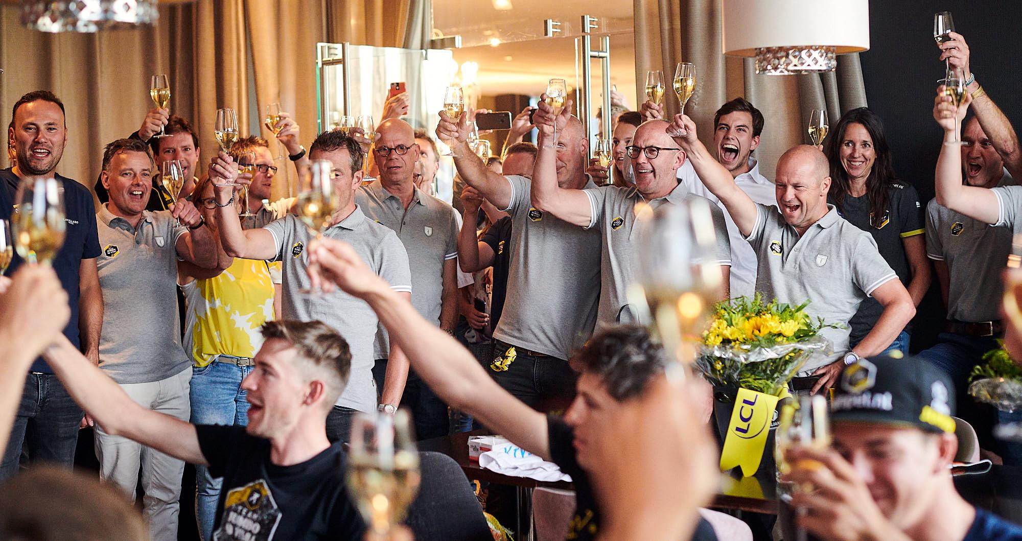Staff making a toast