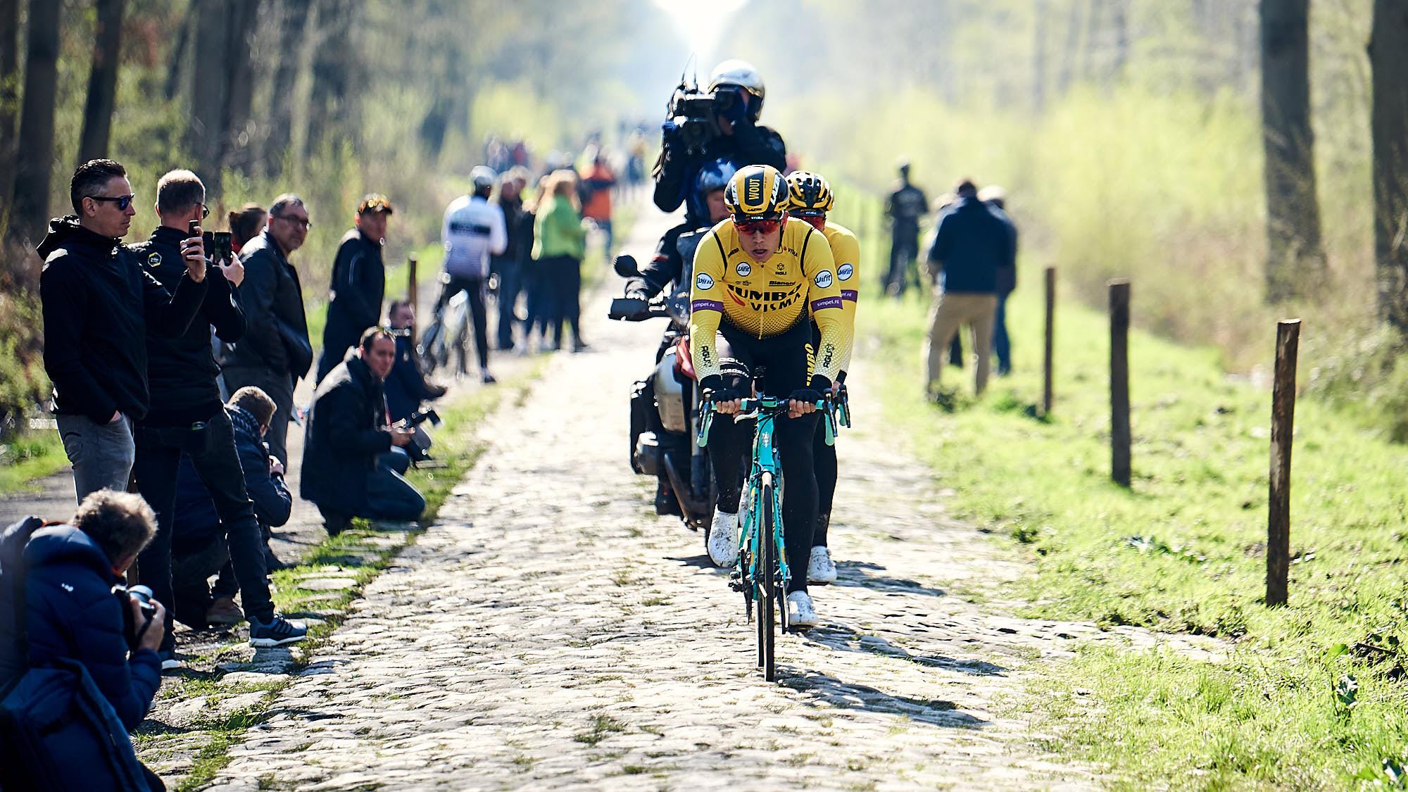 Jumbo-Visma classics rider Wout van Aert doing recon of Paris-Roubaix cobbles section