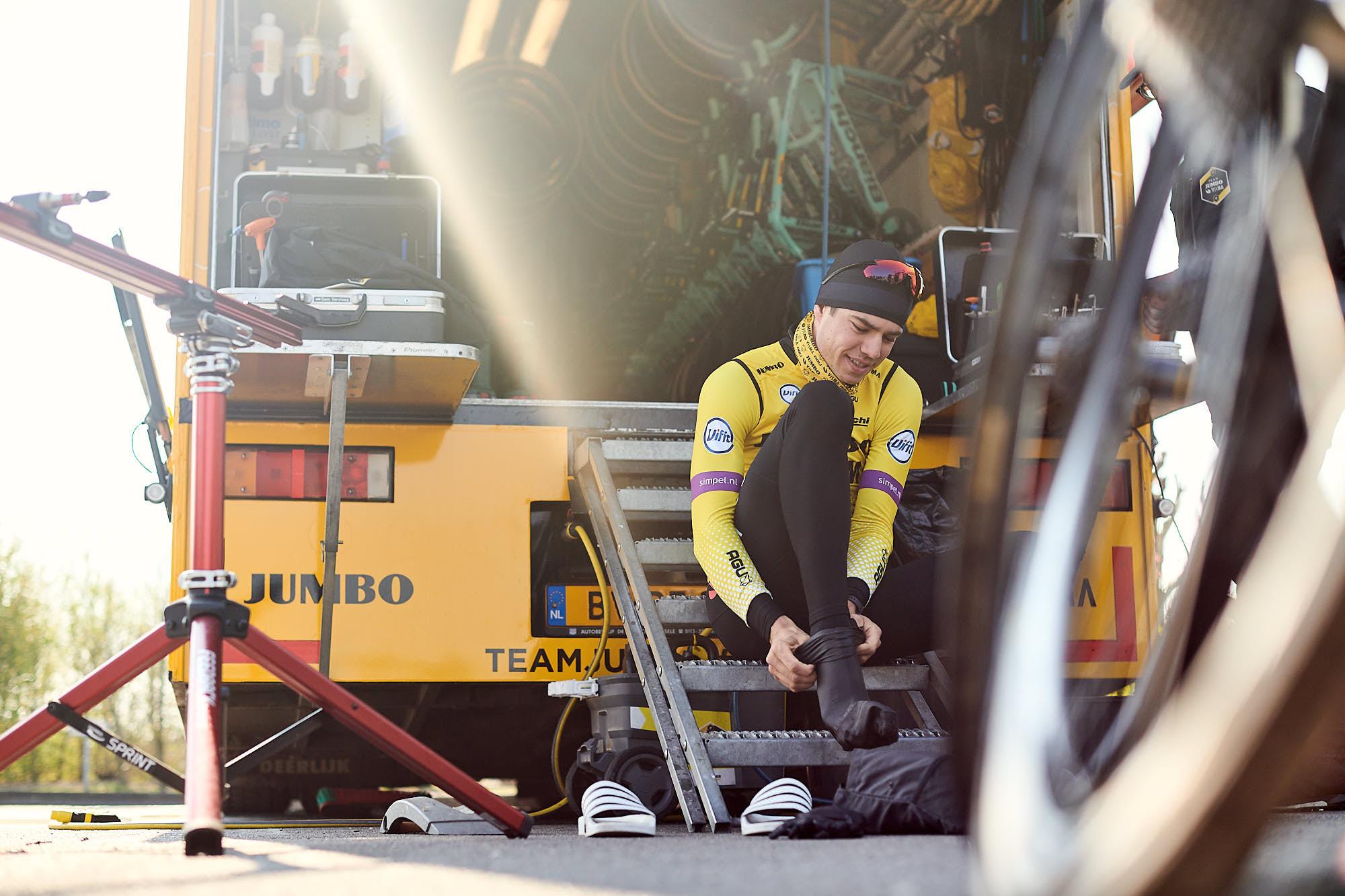 Jumbo-Visma classics rider Wout van Aert preparing his shoes