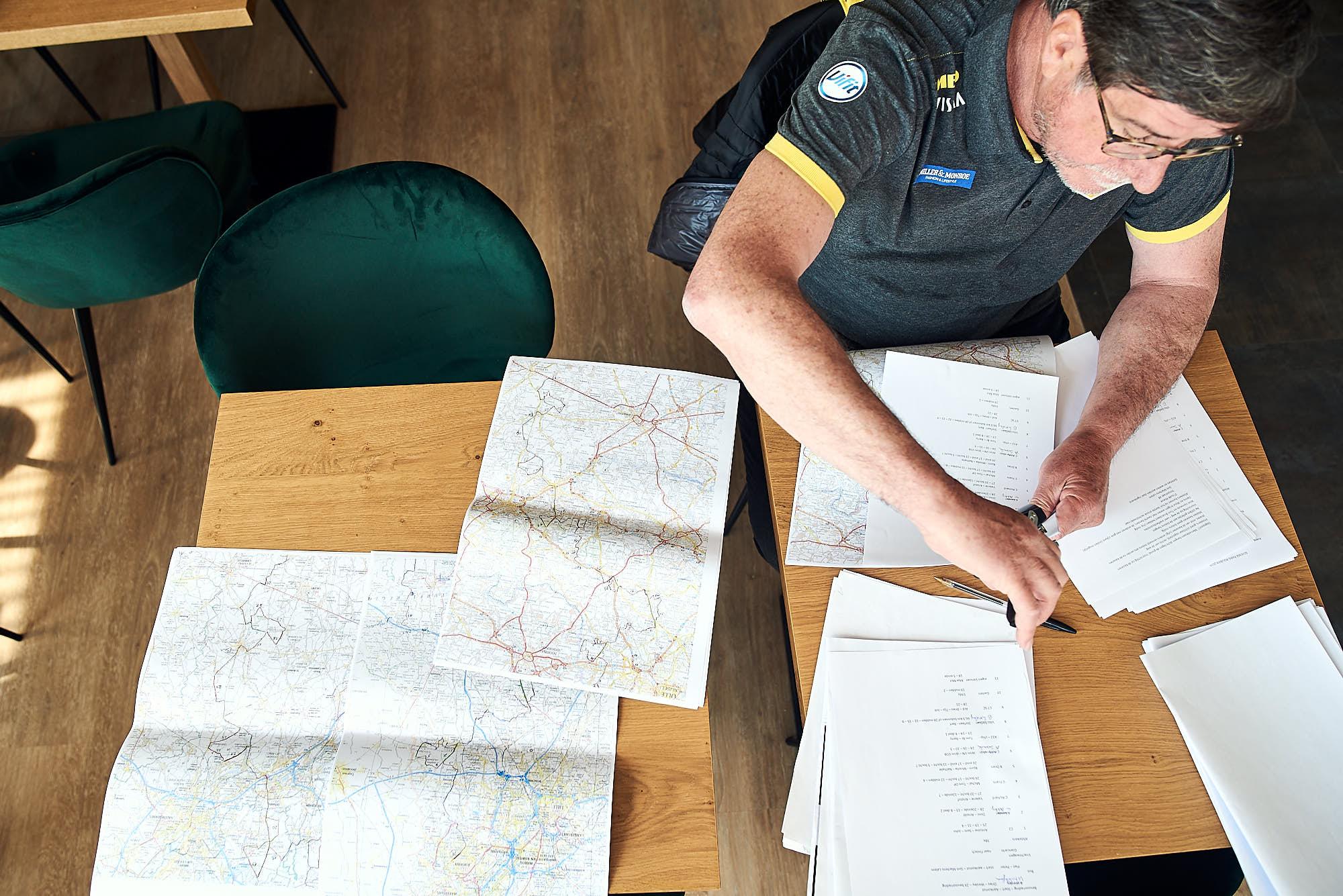 Team Jumbo-Visma member of staff planning logistics for Paris-Roubaix