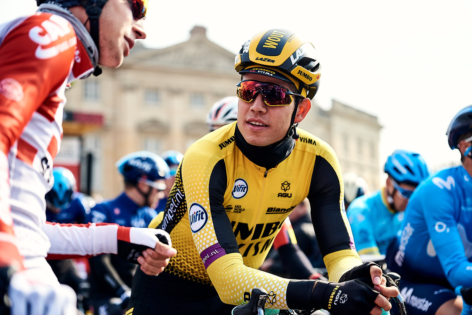 Wout van Aert talking with fellow riders before Paris-Roubaix