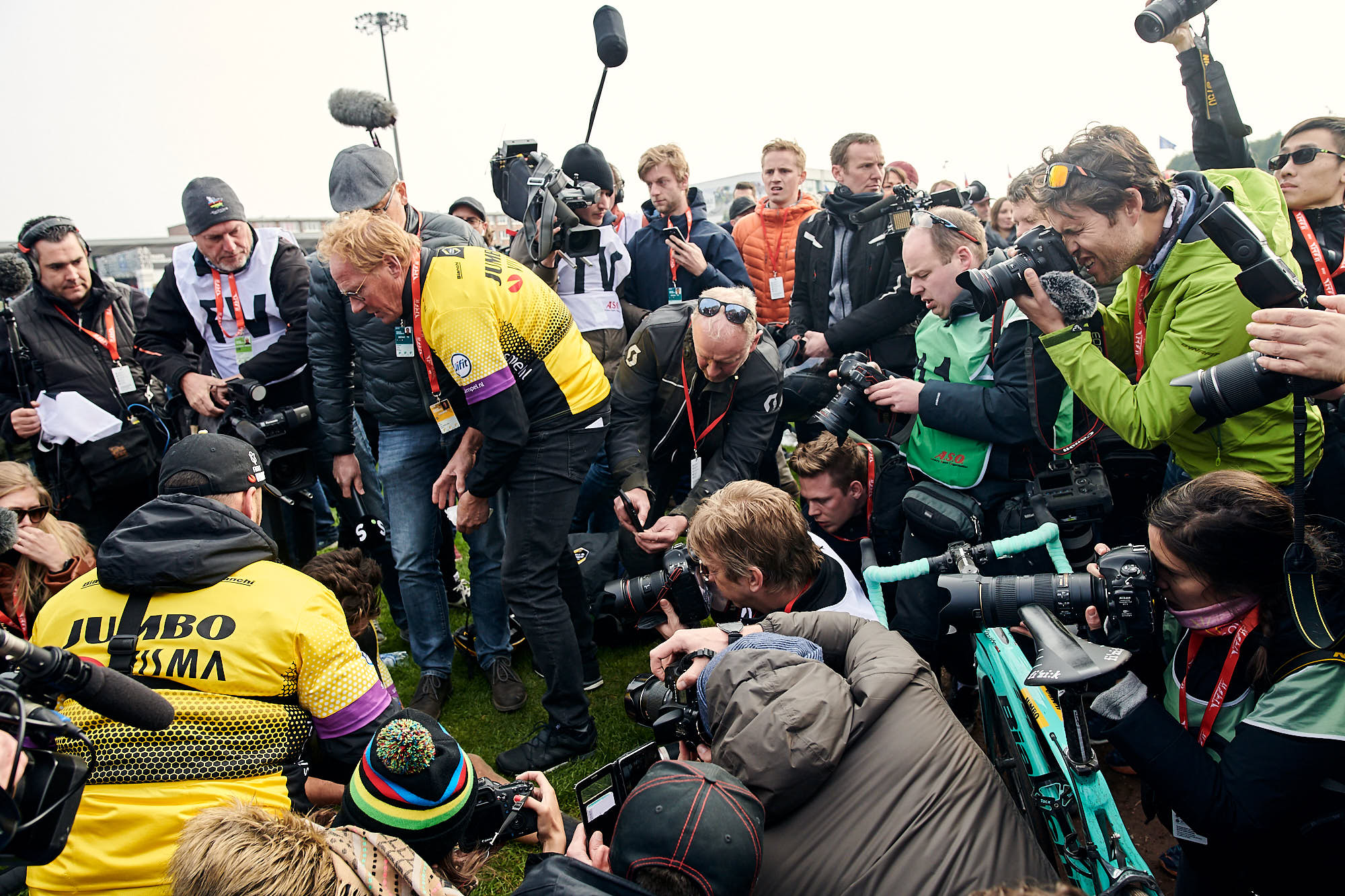Team Jumbo-Visma rider Wout van Aert surrounded by media after Paris-Roubaix in 2019