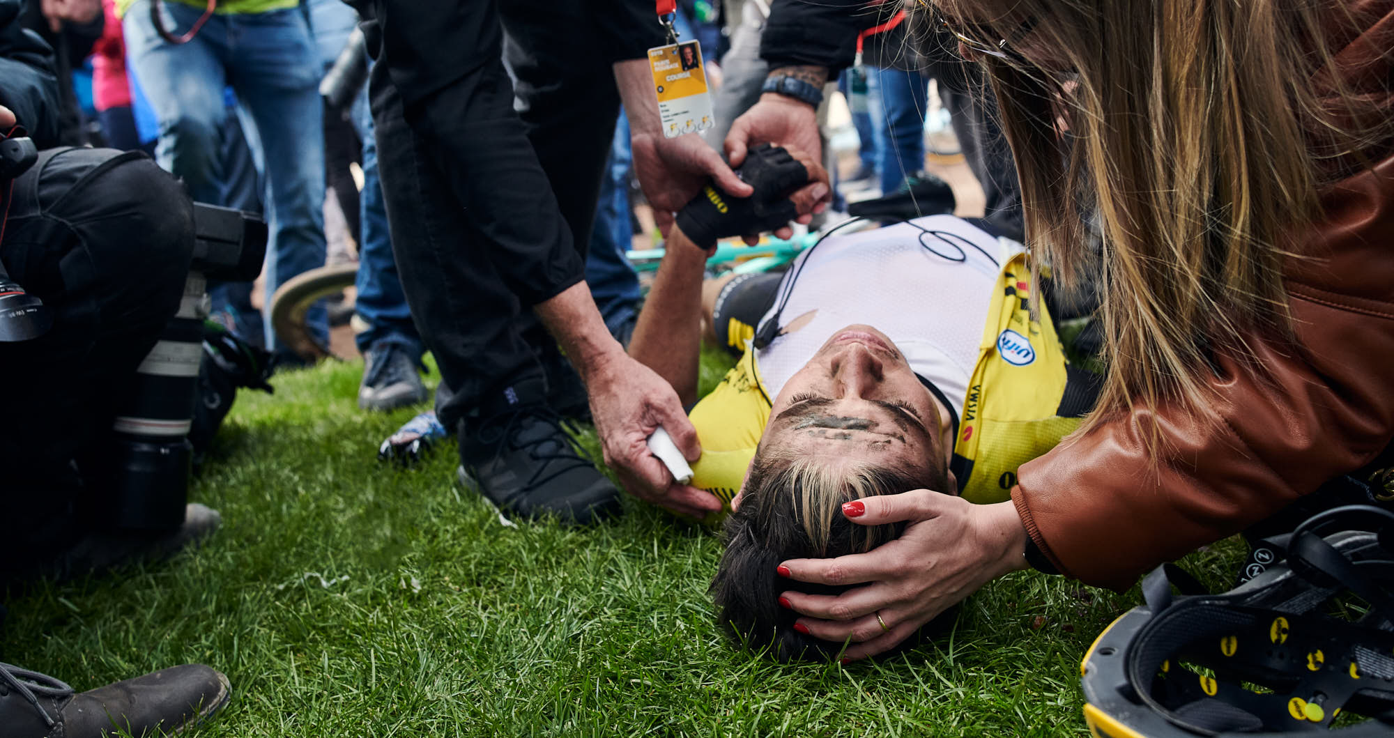 Top Belgian cyclist Wout van Aert being comforted by his wife and soigneur after Paris-Roubaix