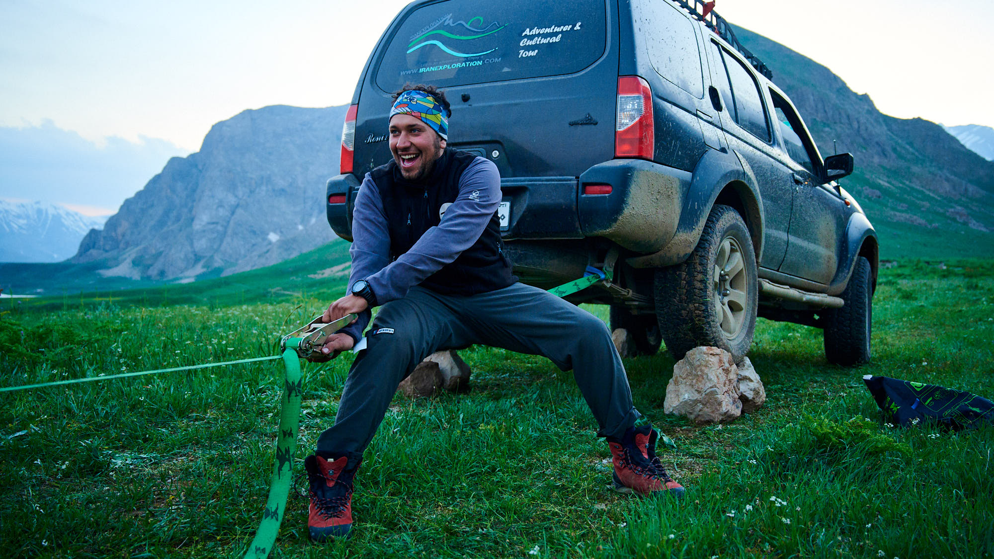 Rigging a slackline in Dar valley in Iran