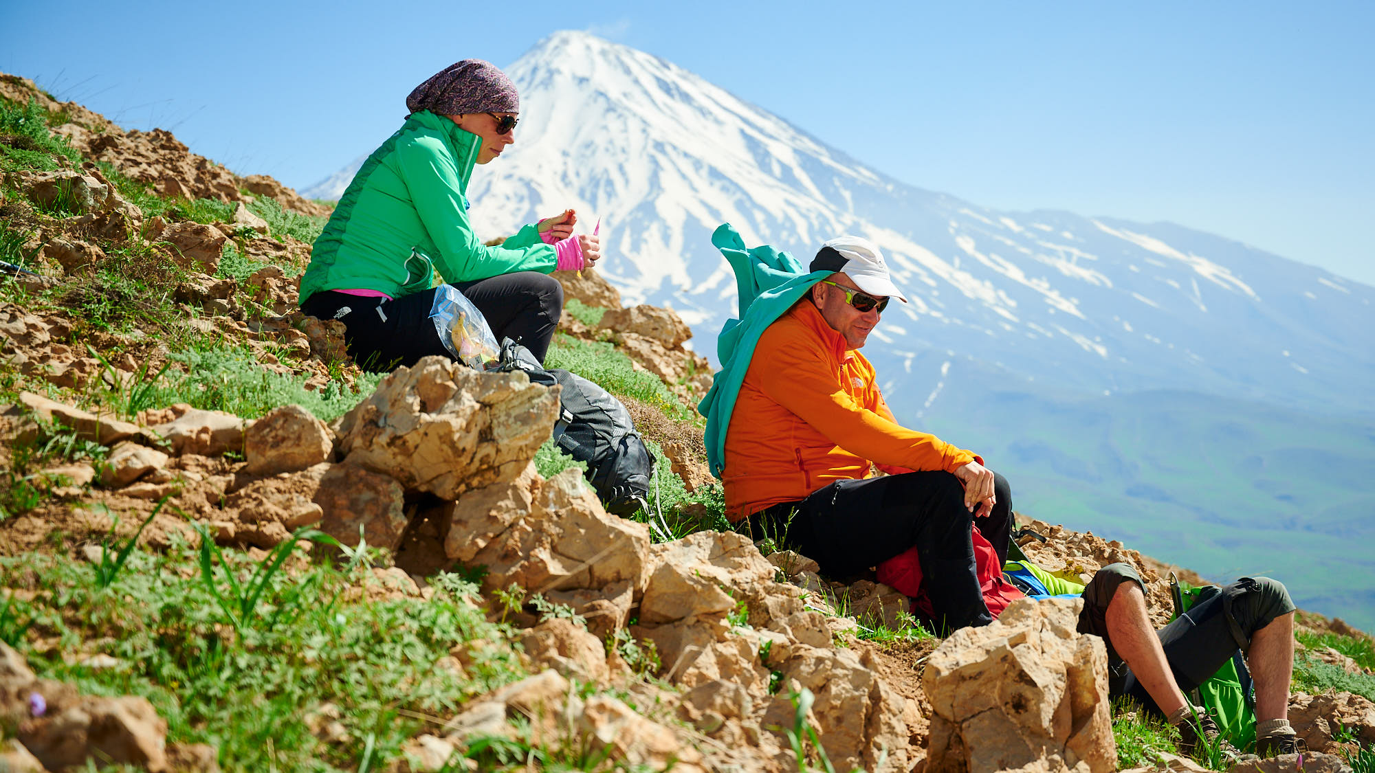 Climbers with a view of Mount Damavand in Iran