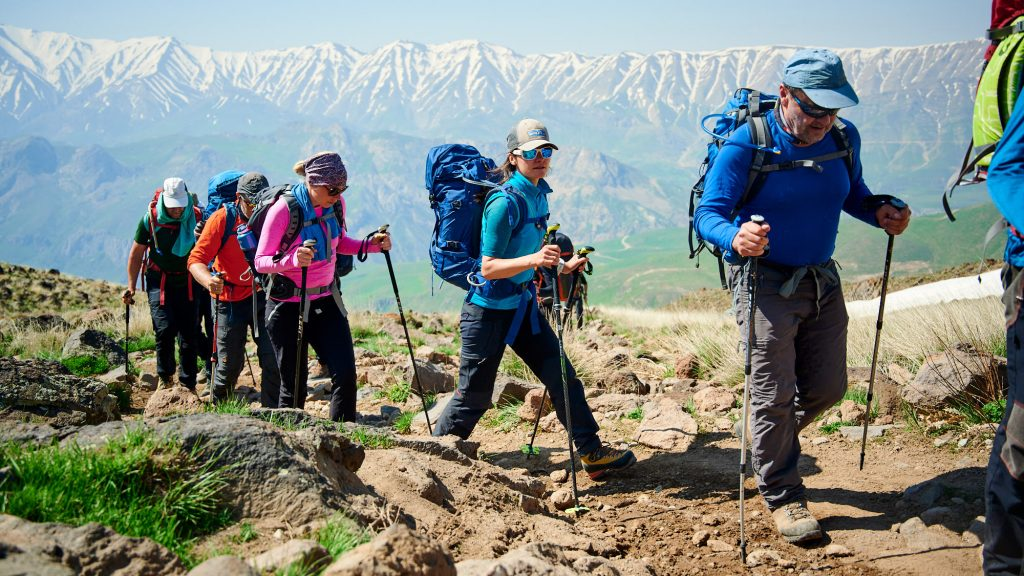 Group of mountaineers hiking up to Mount Damavand high camp
