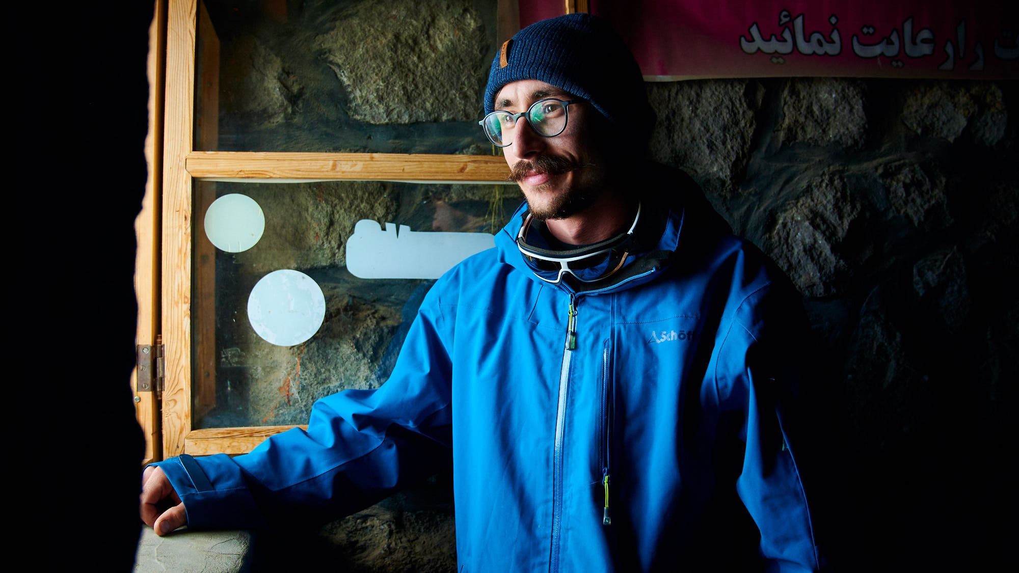 Indoor portrait of a climber in Mount Damavand high camp