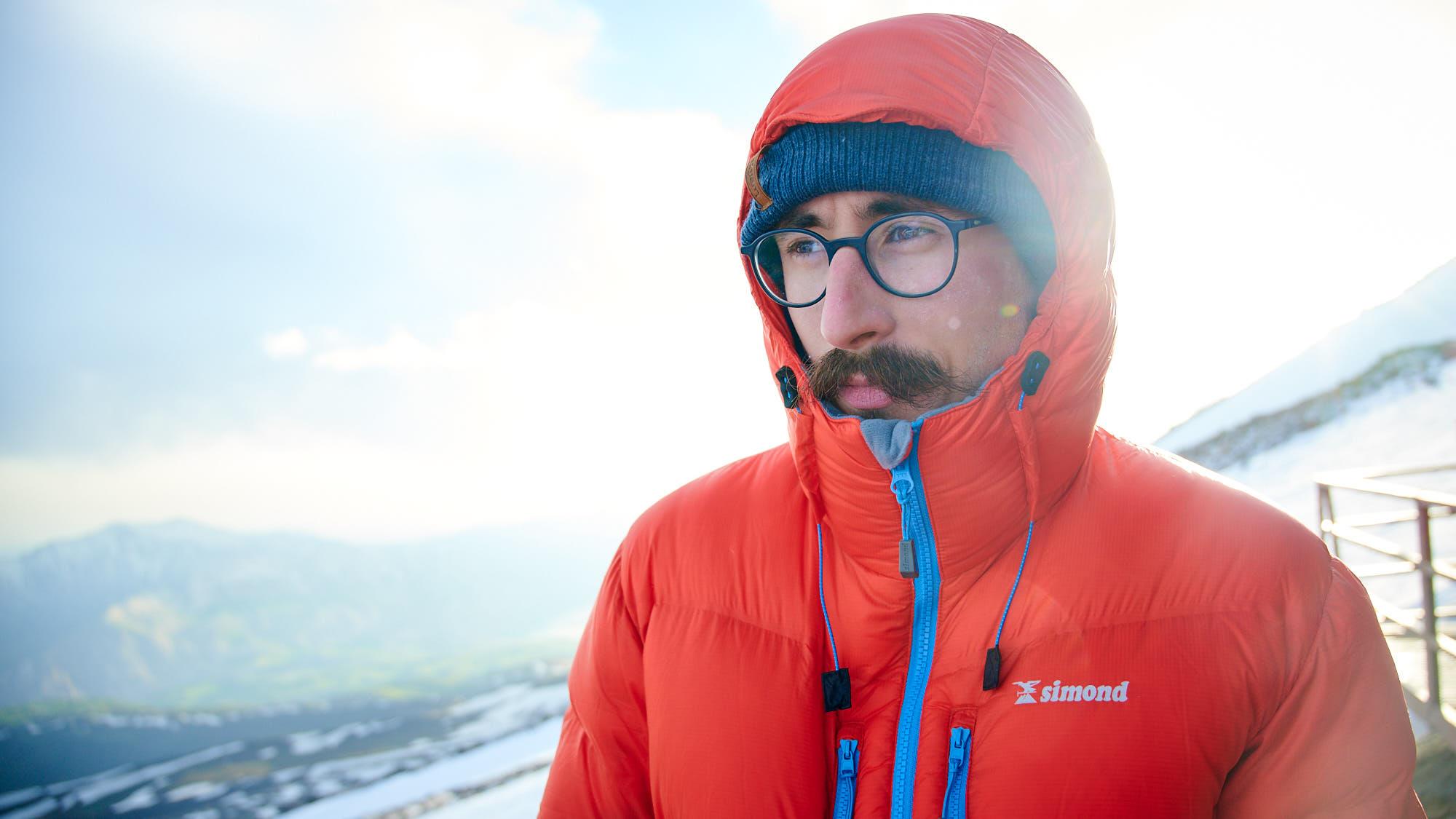 Mountaineer wearing down jacket in Mount Damavand high camp