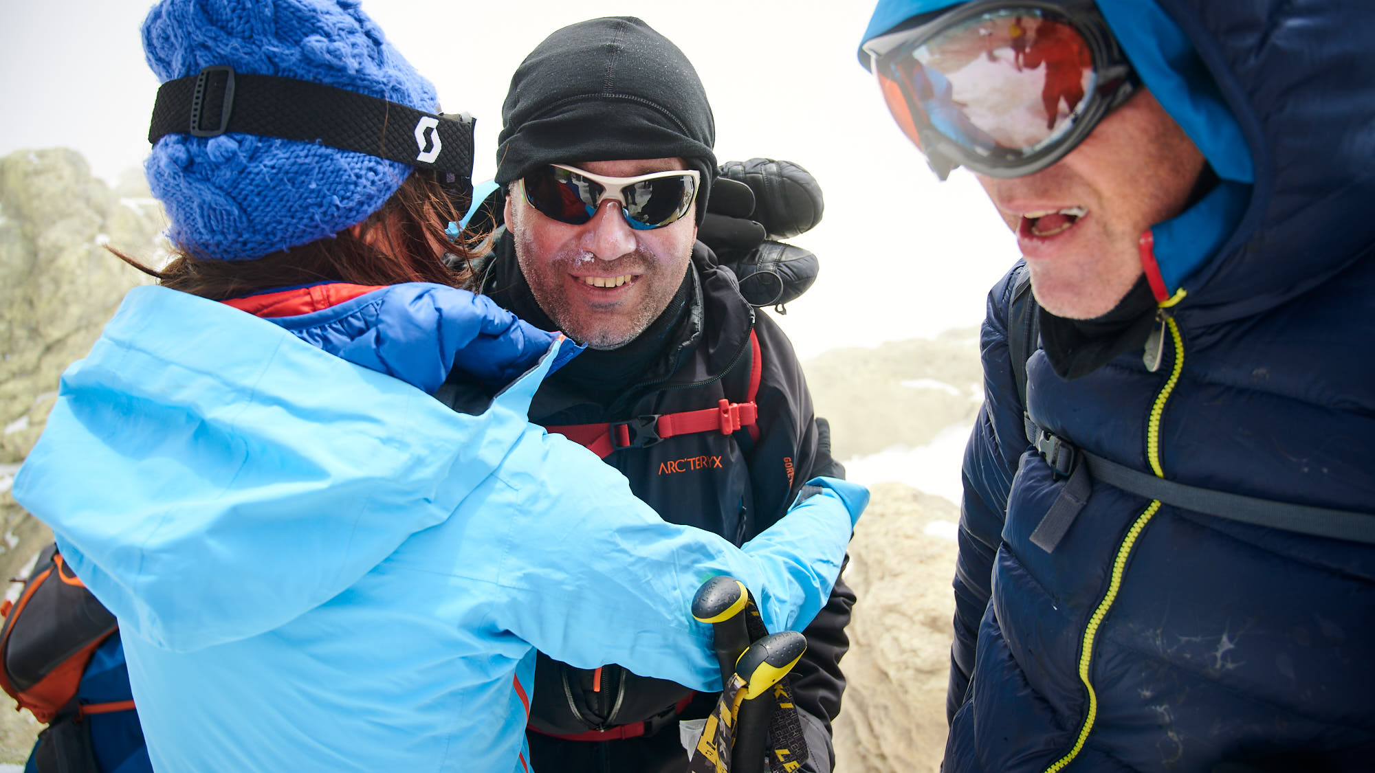Mountaineer being welcomed on top of Mount Damavand in Iran