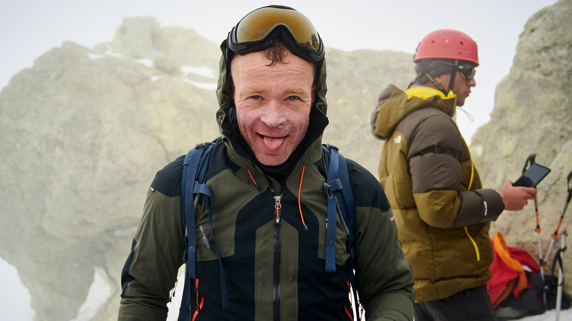 Relieved mountainer on the summit of Mount Damavand in Iran