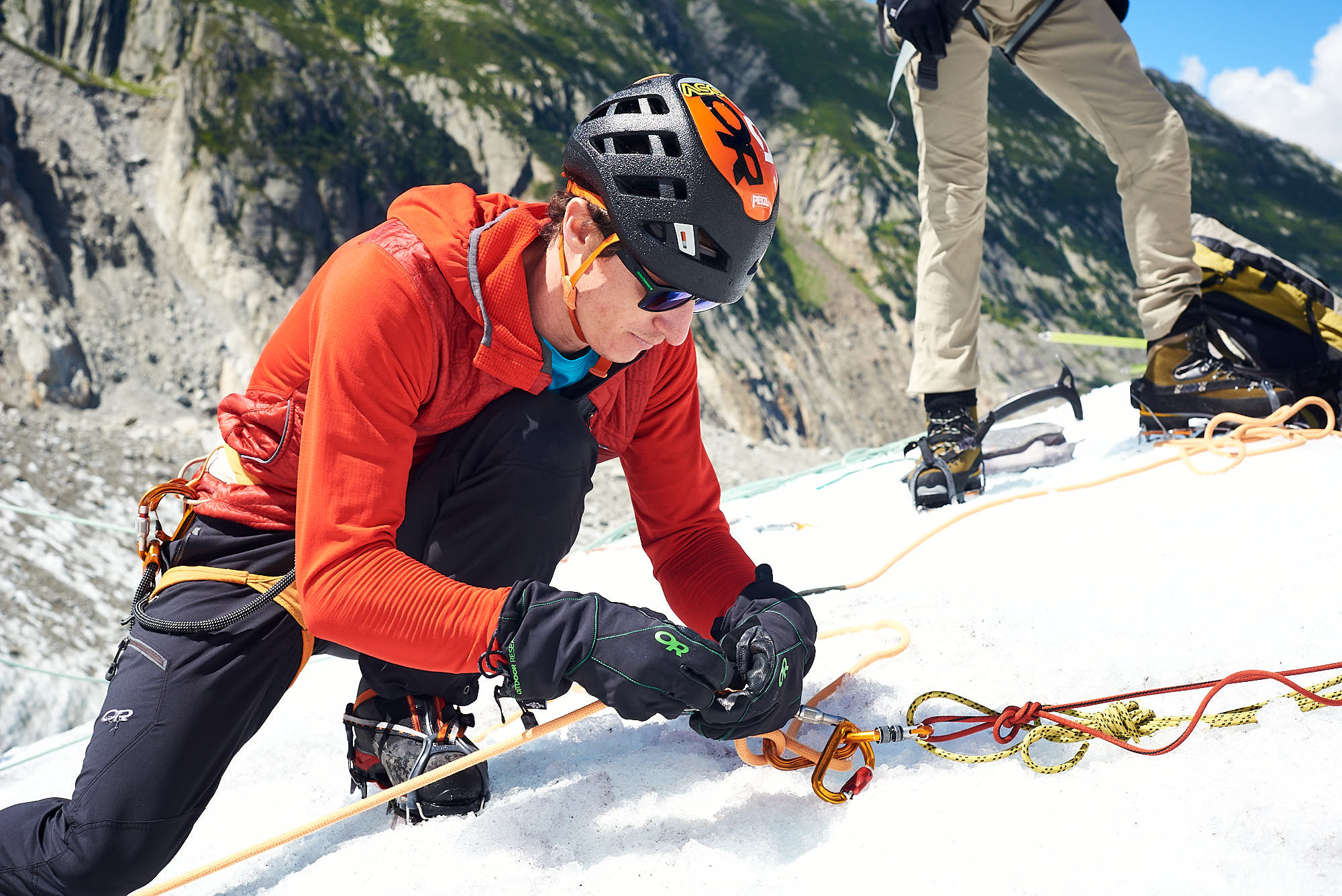 Mountain guide setting up an anchor point on the Mer de Glace glacier