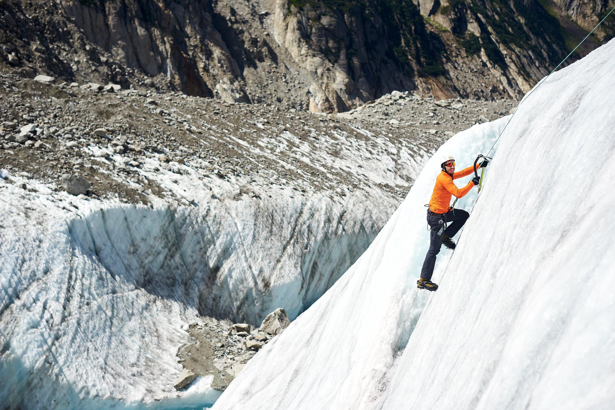 Alpinist ice climbing on the Mer de Glace glacier