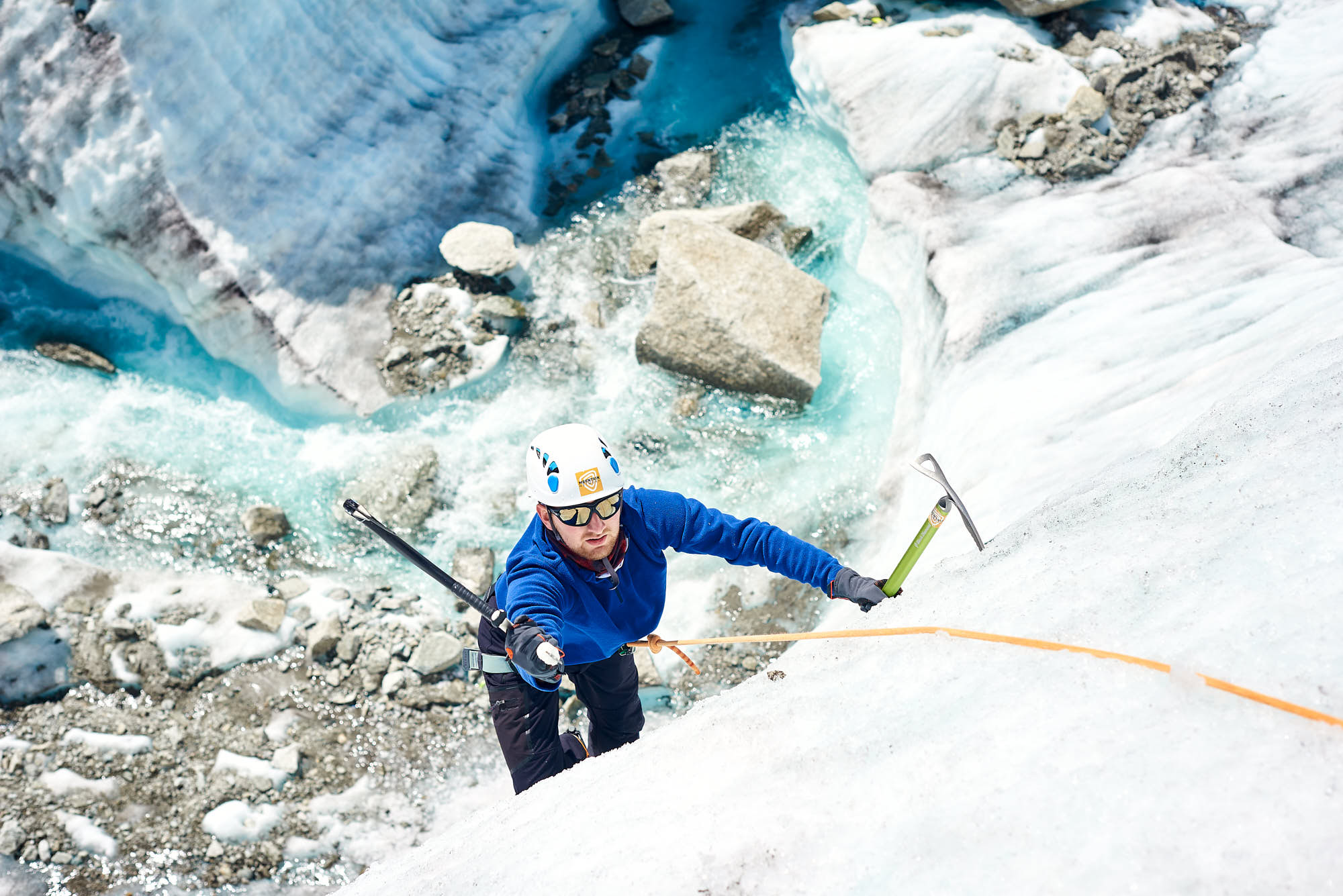 Mountaineer ice climbing on the Mer de Glace glacier