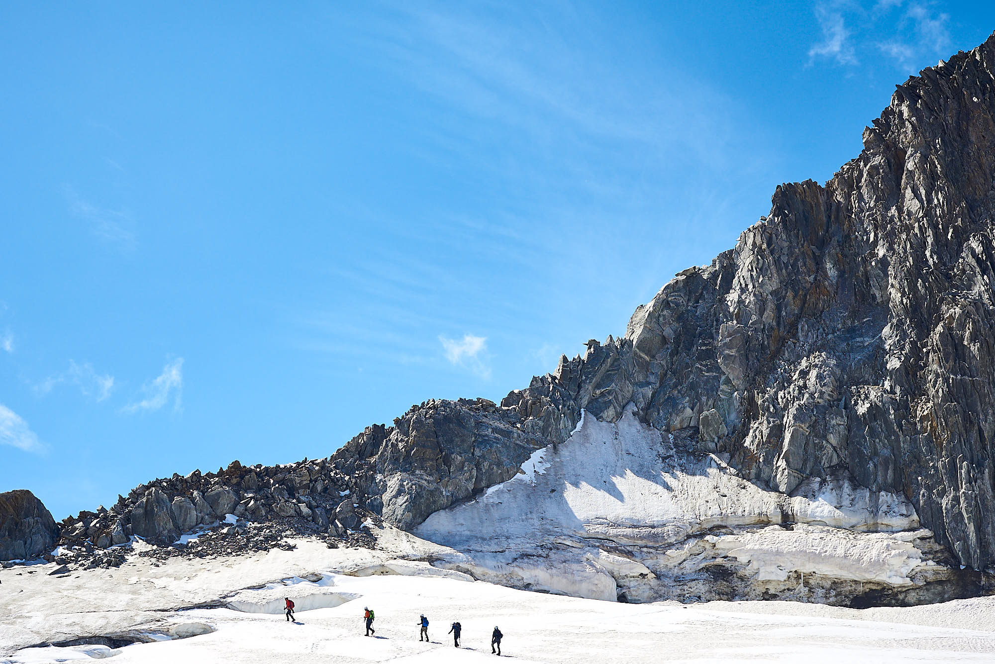 Mountaineers approaching a ridge in the Italian Alps