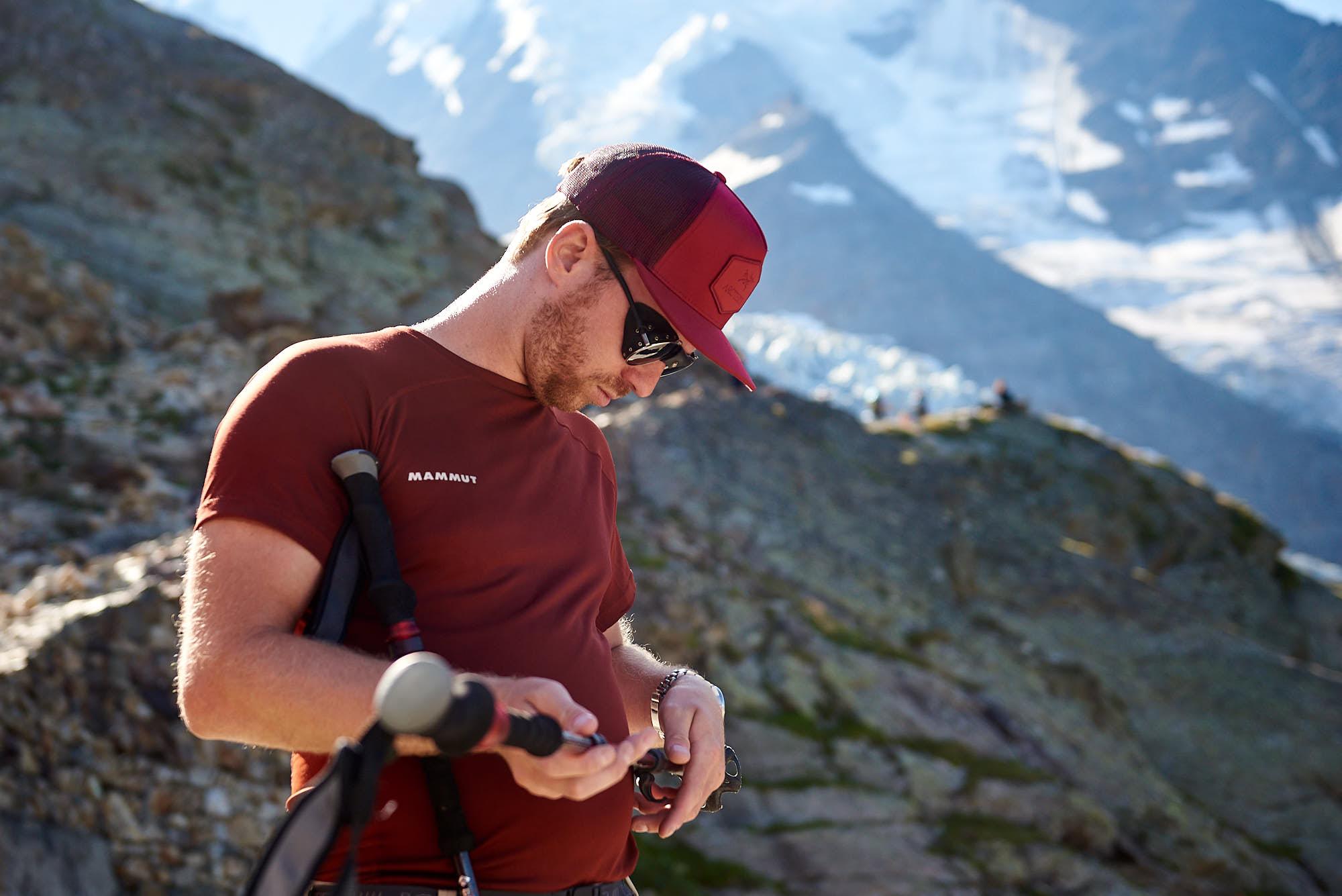 Alpinist preparing gear near Mont Blanc in France