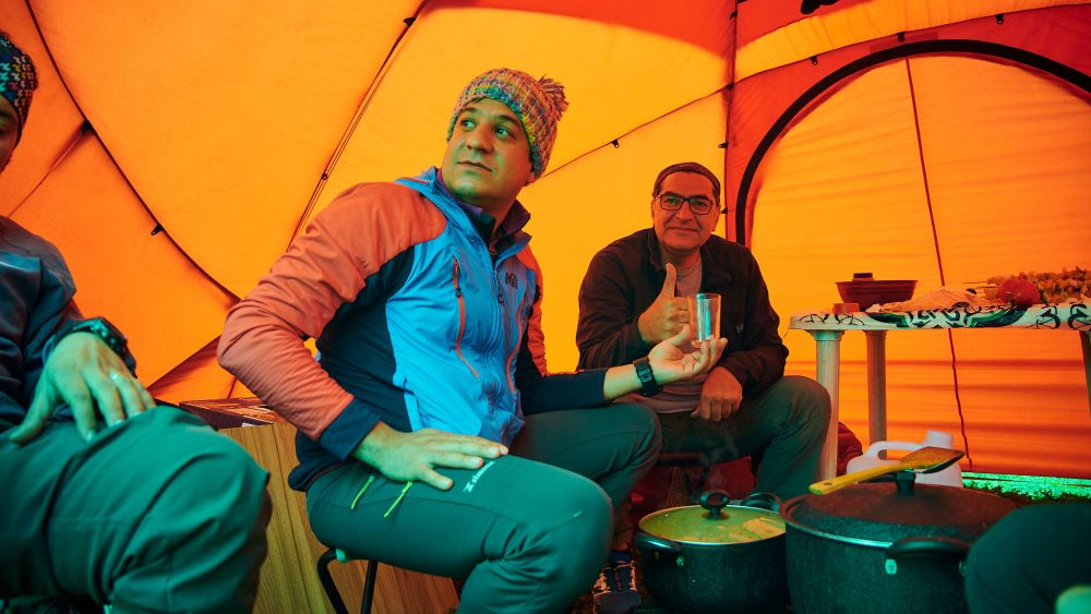 Mountain guides in a tent after a hike in Iran