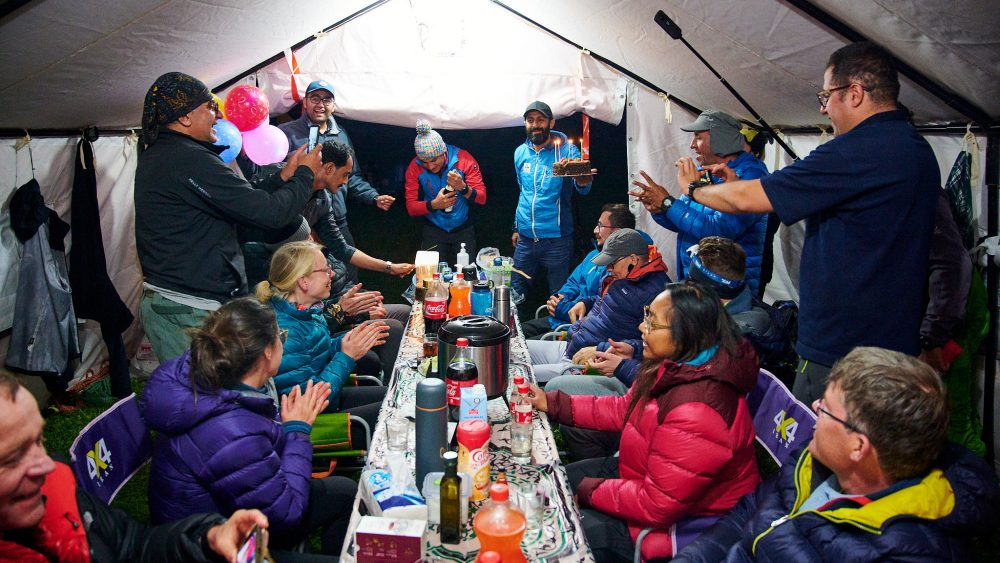 Climbers celebrating a birthday in a tent in Iran's Dar valley