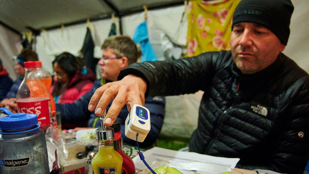 Climber in Iran checking his blood saturation before a summit bid